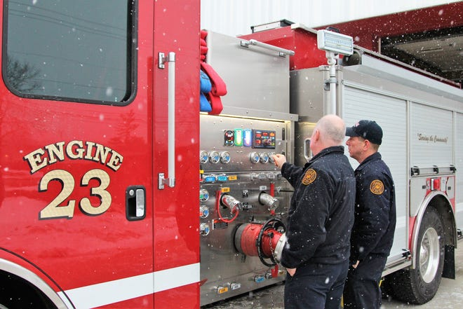 Firefighters Jim White and Lt. Ryan Coppus examine the city's newest fire engine on Tuesday. It replaces the old engine 23 that had been in service for over 20 years. Mounting repair costs prompted the department to ask city officials for a new truck towards the end of 2017.