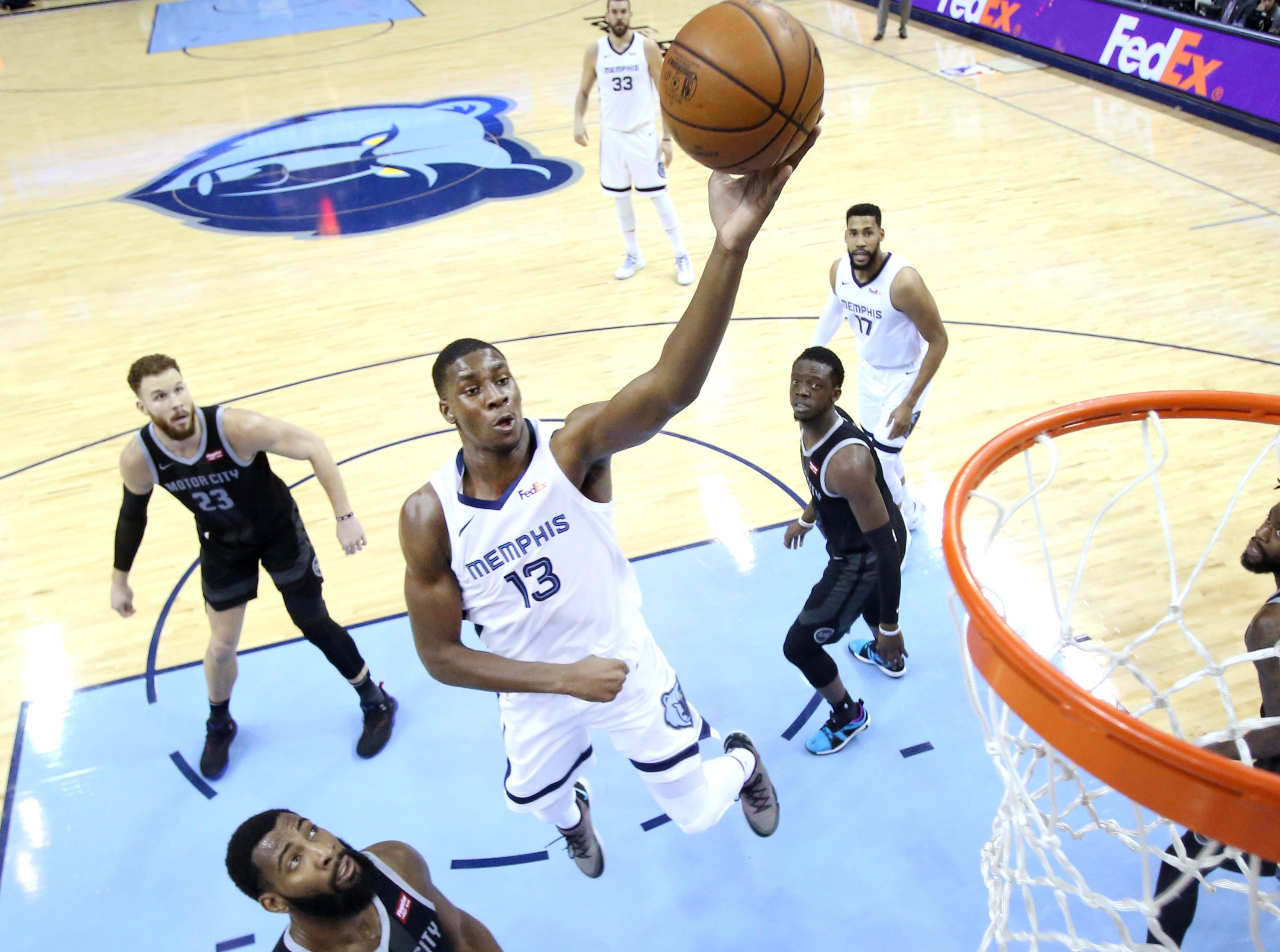 Memphis Grizzlies forward Jaren Jackson Jr. shoots the ball over Detroit Pistons center Andre Drummond during their game at the FedExForum on Wednesday, January 2, 2019.