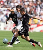 Marc Burch (foreground) defending Kaka in a game in 2009.