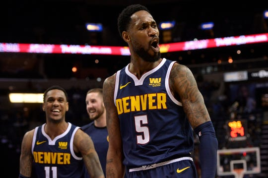Denver Nuggets guard Will Barton (5) celebrates after scoring in the second half of an NBA basketball game against the Memphis Grizzlies Monday, Jan. 28, 2019, in Memphis, Tenn. (AP Photo/Brandon Dill)