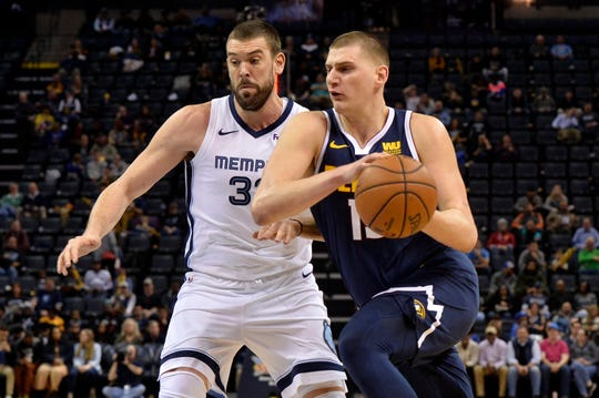 Denver Nuggets center Nikola Jokic, right, drives against Memphis Grizzlies center Marc Gasol in the first half of an NBA basketball game Monday, Jan. 28, 2019, in Memphis, Tenn. (AP Photo/Brandon Dill)