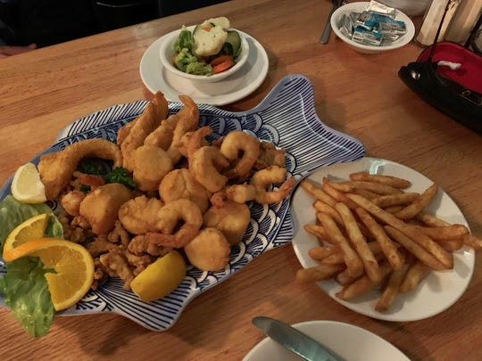 A lightly fried combination platter – featuring shrimp, fish fingers, scallops, oysters and clams from Pelican Bend, Isles of Capri.