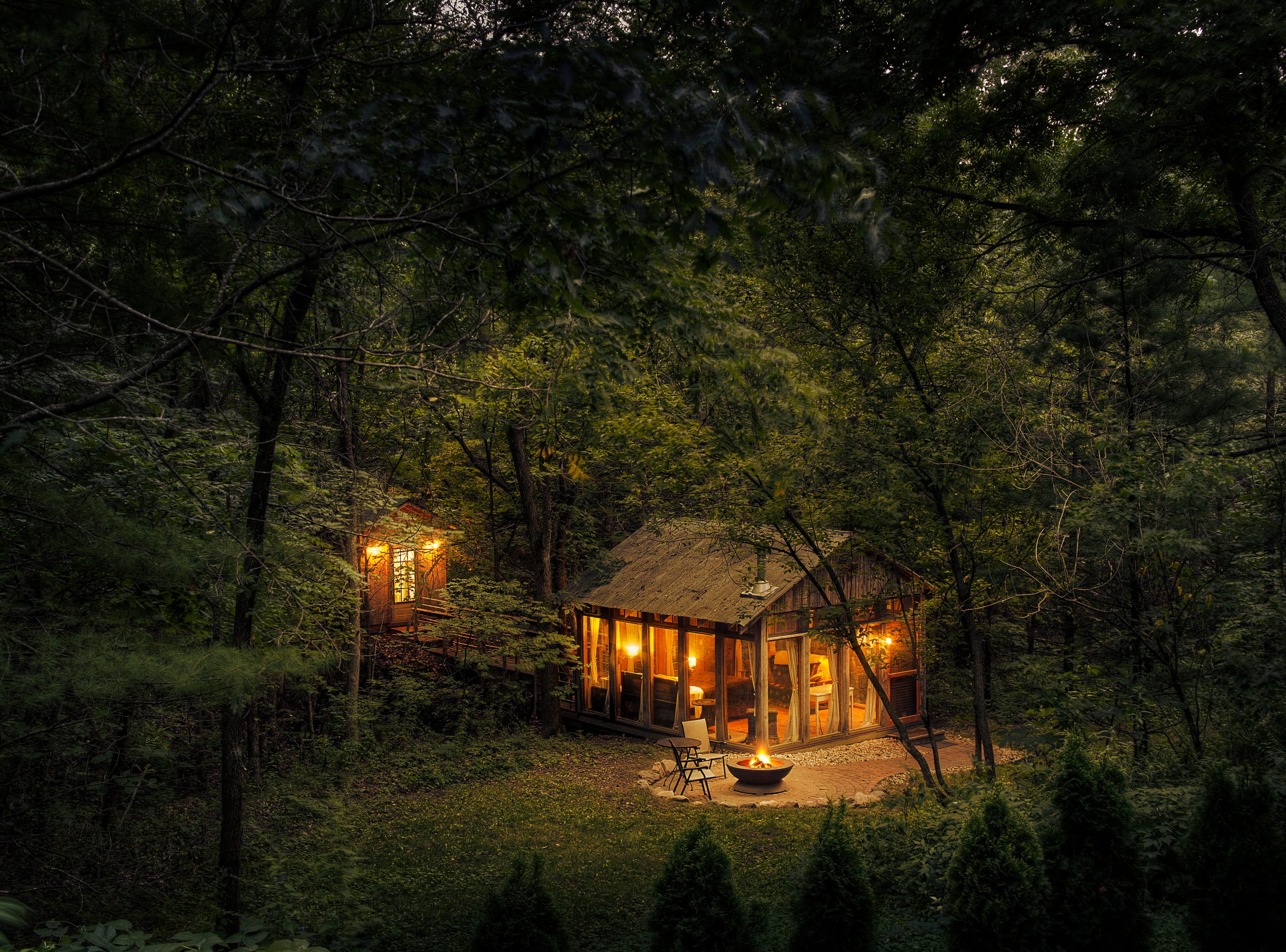 The Glass House put Candlewood Cabins on the map when Susan and Norbert Calnin built the one-room house and began renting it out in 2006. They later added a detached bathroom and kitchenette accessible via a footbridge.
