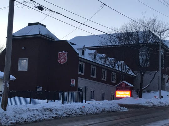 As the sun sets and the forecasted frigid night begins on Jan. 29, the Salvation Army shelter at 445 Madison St. in Waukesha takes in homeless men seeking shelter. Temperatures were expected to dip in excess of minus-25 degrees on consecutive nights, with even deeper wind chills.