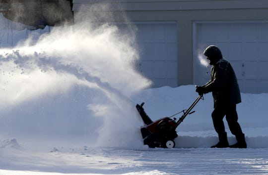 Grigoriy Gurevich braves the chilly temperatures to blow the snow off his driveway on North Pheasant Lane in Mequon. What's being billed as a once-in-a-generation deep freeze will hit Wisconsin Tuesday night through Friday morning, bringing dangerously low temperatures and wind chills that haven't been seen in a couple of decades.