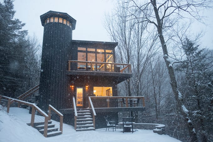 Snow falls around the Woodland House at Candlewood Cabins near Richland Center.