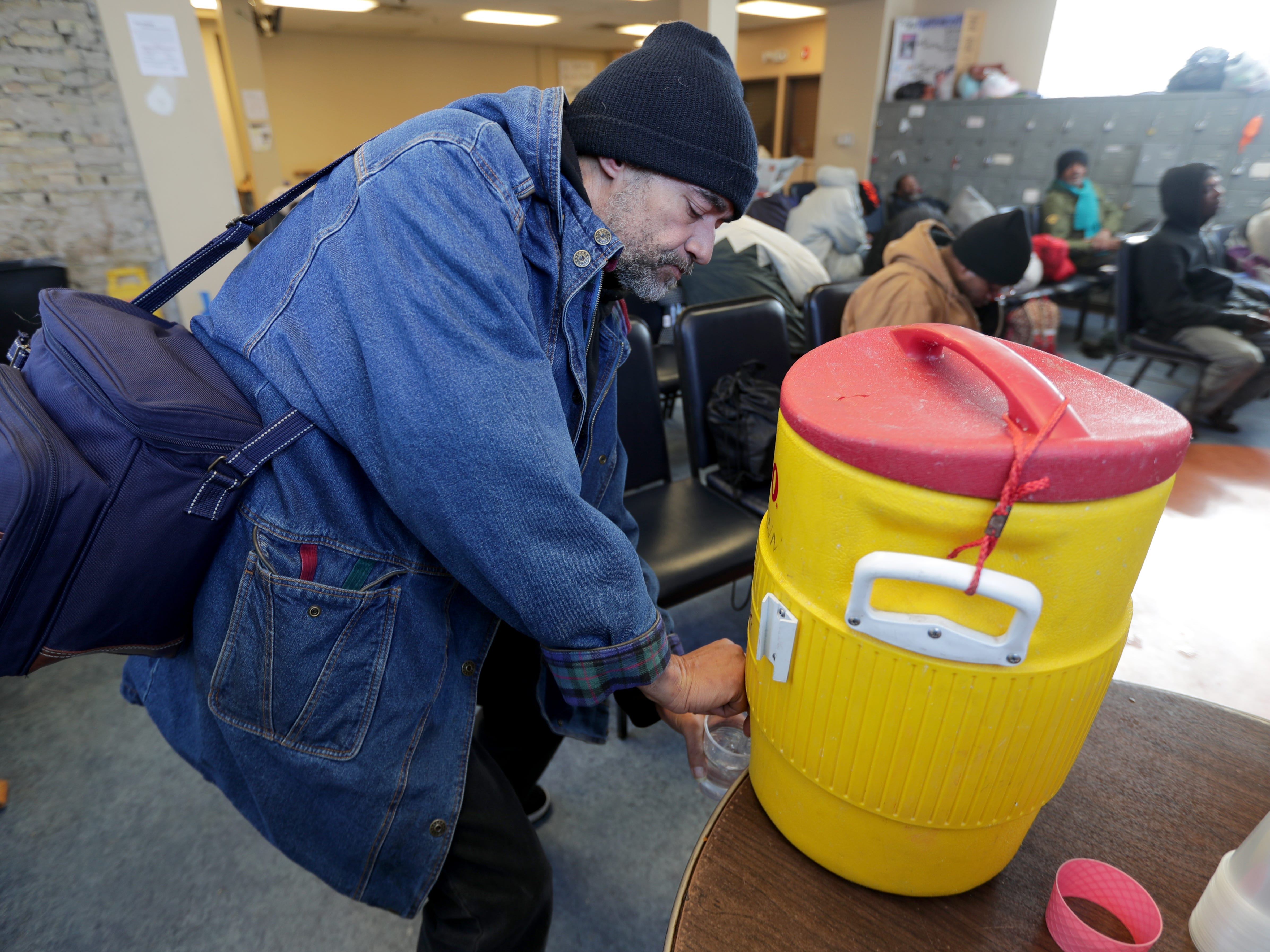 """Thank god for places like this,"" said Timothy Warren as he gets a cup of water at Repairers of the Breach shelter on West Vliet Street in Milwaukee."