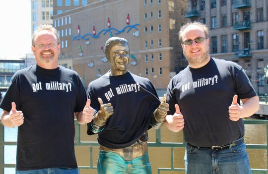 Mark Mudek (left) and Jerry Dutscheck pose with the Bronz Fonz in downtown Milwaukee. The pair own the Military Collectibles Shop in West Allis and are gearing up for their 22nd year as vendors at the Show of Shows in Louisville, Kentucky, in February.