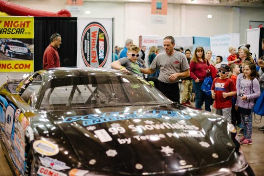 See race cars that will be in the ARCA Midwest Tour race at the Milwaukee Mile, and a firetruck from the West Allis Fire Department at the Milwaukee Kids Expo. This picture is from a previous Madison Kids Expo.