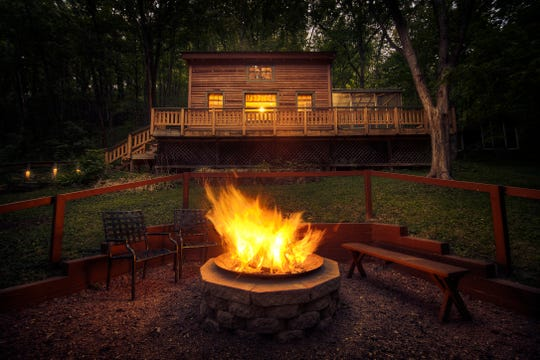 A bonfire blazes outside the Hillside Cabin at Candlewood Cabins near Richland Center. The cabin was the property's first available for rent.