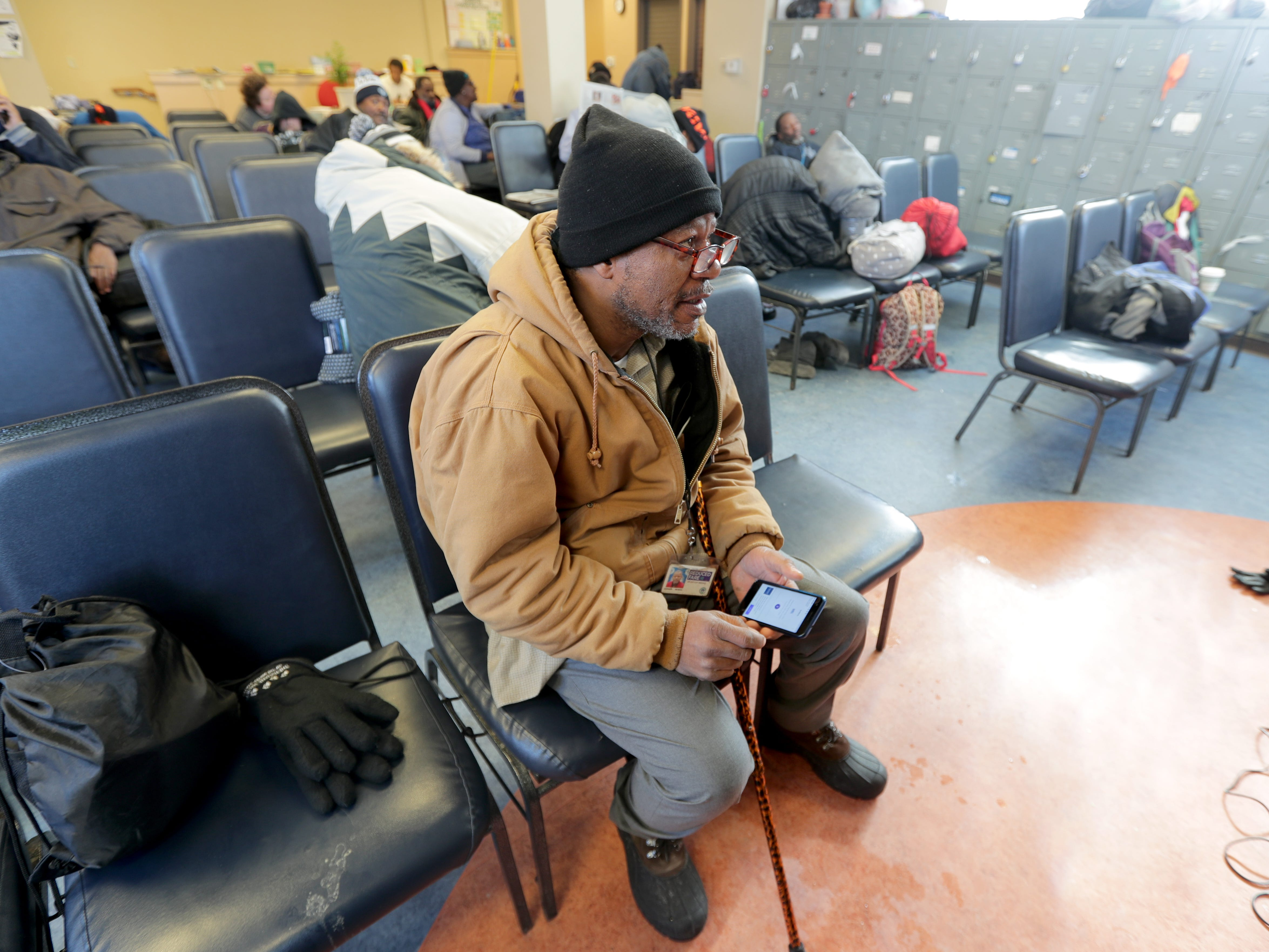 Aportier Weeks finds warmth at Repairers of the Breach shelter on West Vliet Street in Milwaukee.