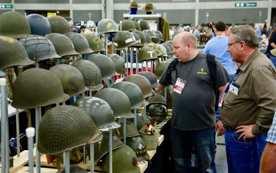 Rows of military helmets were for sale at the 2017 Show of Shows in Louisville, Kentucky.