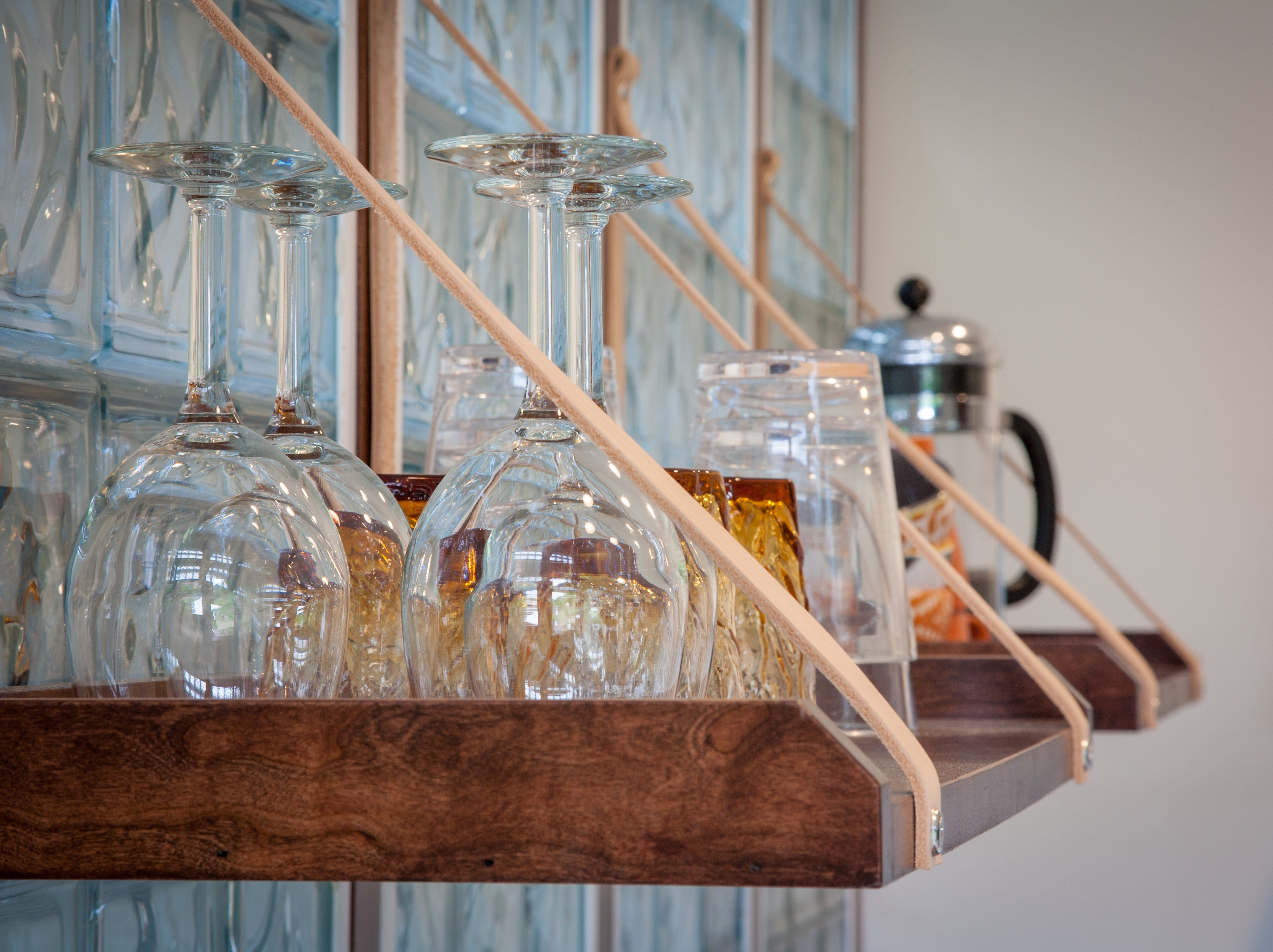 The kitchen in the Meadow House at Candlewood Cabins is fully stocked with glassware.