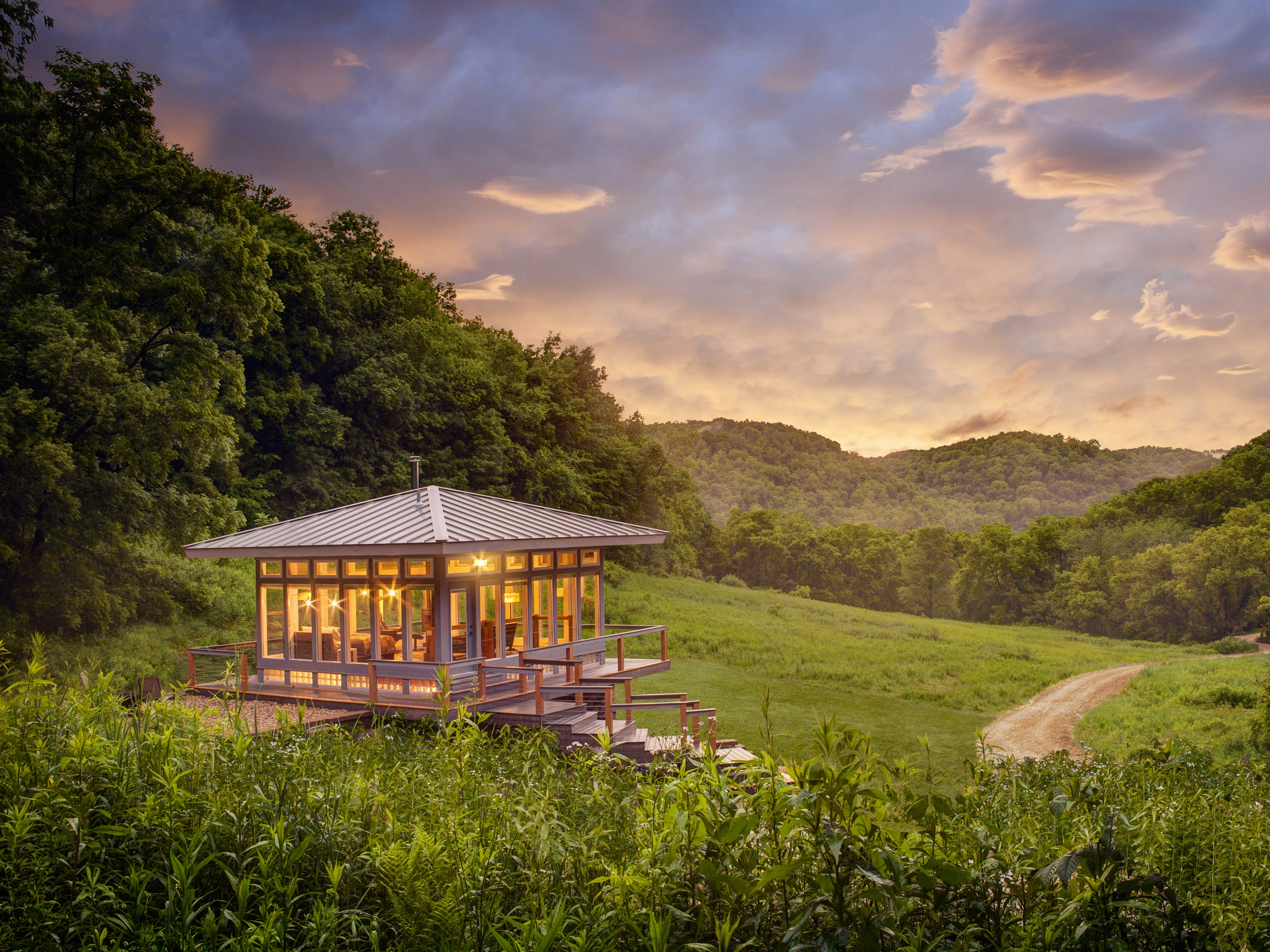 The Meadow House at Candlewood Cabins near Richland Center features four walls of glass panels for taking in views of the surrounding Driftless Area hills.