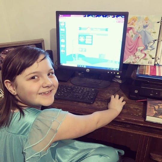 Heather Steinhaus said her second-grade daughter, Lilly, could not wait to get her assignments done during Random Lake Elementary School's digital snow day.