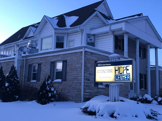 The warmth of the Hope Center's glowing sign stands in contrast to the cold that took hold as the sun set Jan. 29. The center, 502 N. East Ave. in Waukesha, is one of the places homeless people can come to to seek shelter from the extreme cold that threatened their lives.