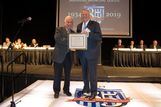 Former Mountain Home Mayor Joe Dillard (left) is presented with an honorary membership to the Arkansas Municipal League by AML President and North Little Rock Mayor Joe A. Smith recently in Little Rock.