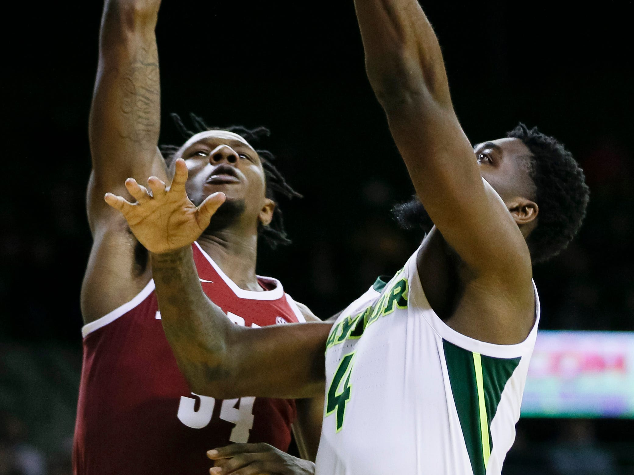 Jan 26, 2019; Waco, TX, USA; Alabama Crimson Tide guard Tevin Mack (34) attempts to block a shot by Baylor Bears guard Mario Kegler (4) during the second half at Ferrell Center. Mandatory Credit: Ray Carlin-USA TODAY Sports