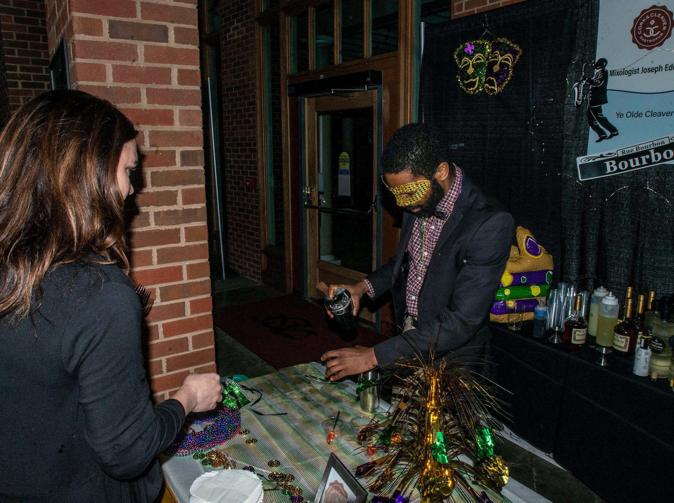 The Cork and Cleaver's masked mixologist serves Ye Olde Cleaver drinks. The annual Feast of Flavours was held Monday, Jan. 28, 2019, at Alabama Shakespeare Festival in Montgomery.
