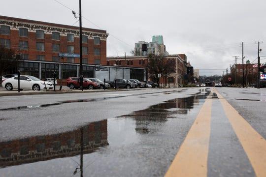 Rain puddles up Tallapoosa Street in Montgomery, Ala., on Tuesday, Jan. 29, 2019.
