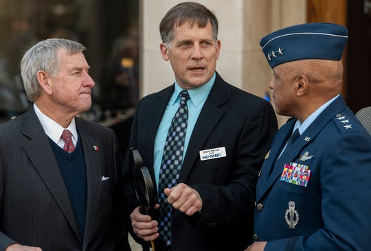 Montgomery Mayor Todd Strange, from left, MGMWERX  Director Steve Warner and Commander and President of Air University Lt. Gen. Anthony Cotton talk at the public opening of MGMWERX, the Air Force innovation center, in downtown Montgomery, Ala., on Tuesday January 29, 2019.