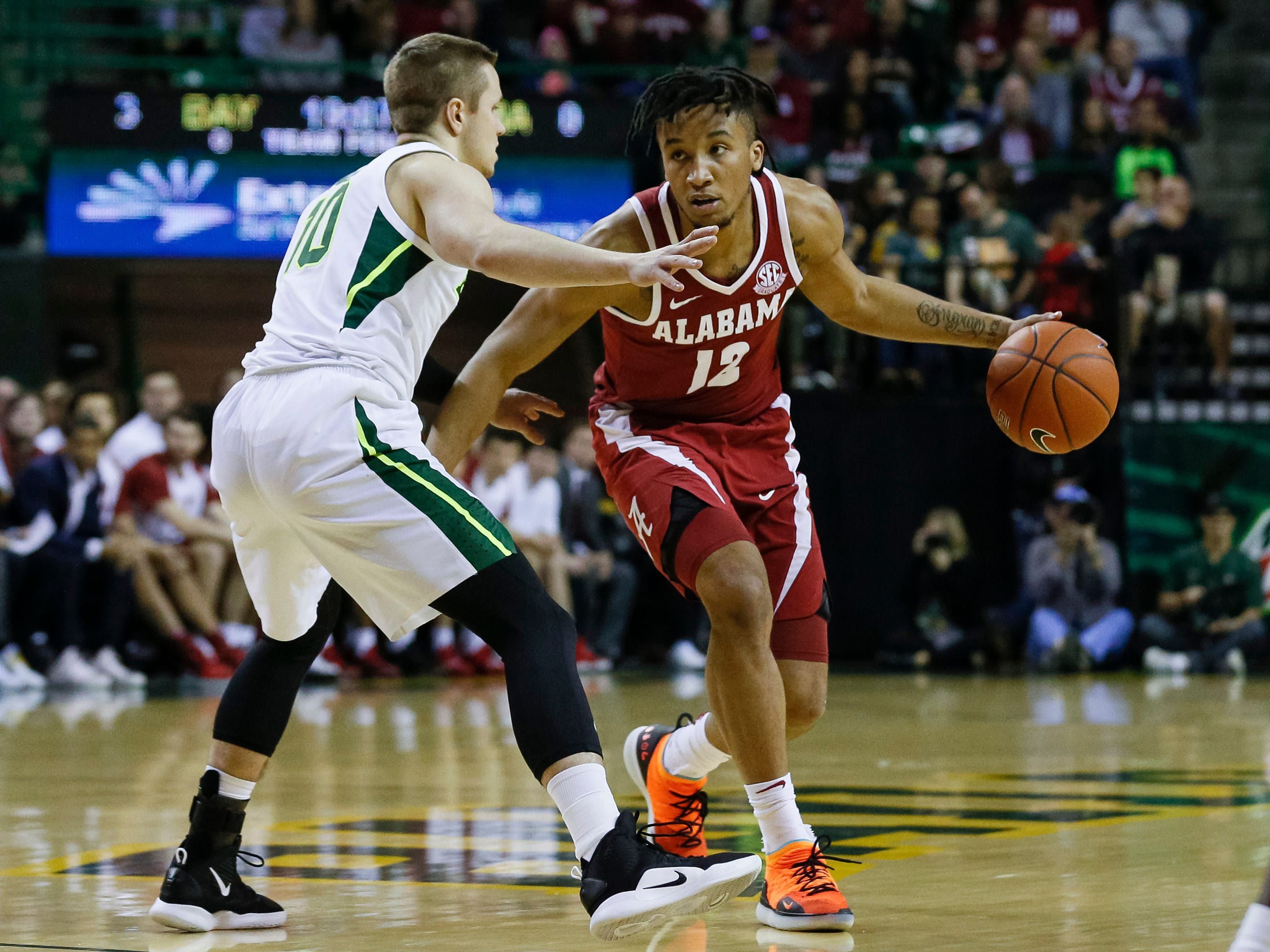 Jan 26, 2019; Waco, TX, USA; Alabama Crimson Tide guard Dazon Ingram (12) dribbles the ball around Baylor Bears guard Makai Mason (10) during the first half at Ferrell Center. Mandatory Credit: Ray Carlin-USA TODAY Sports