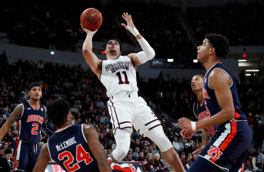 Mississippi State guard Quinndary Weatherspoon (11) attempts a shot over several Auburn players including forward Anfernee McLemore (24) and guard Bryce Brown (2) on Saturday, Jan. 26, 2019, in Starkville, Miss. Mississippi State won 92-84.