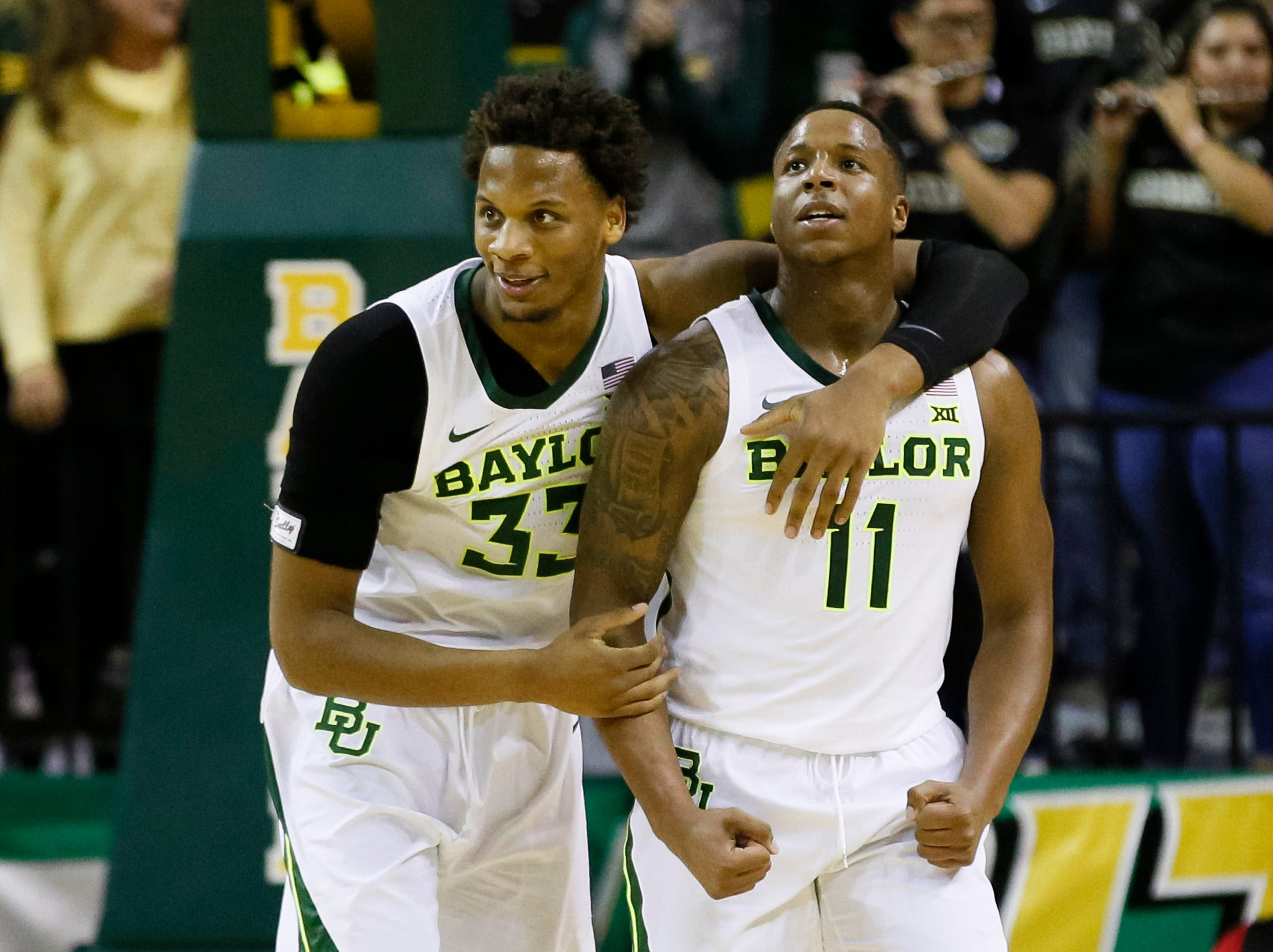 Jan 26, 2019; Waco, TX, USA; Baylor Bears forward Freddie Gillespie (33) hugs guard Mark Vital (11) after Alabama Crimson Tide called a timeout during the second half at Ferrell Center. Mandatory Credit: Ray Carlin-USA TODAY Sports