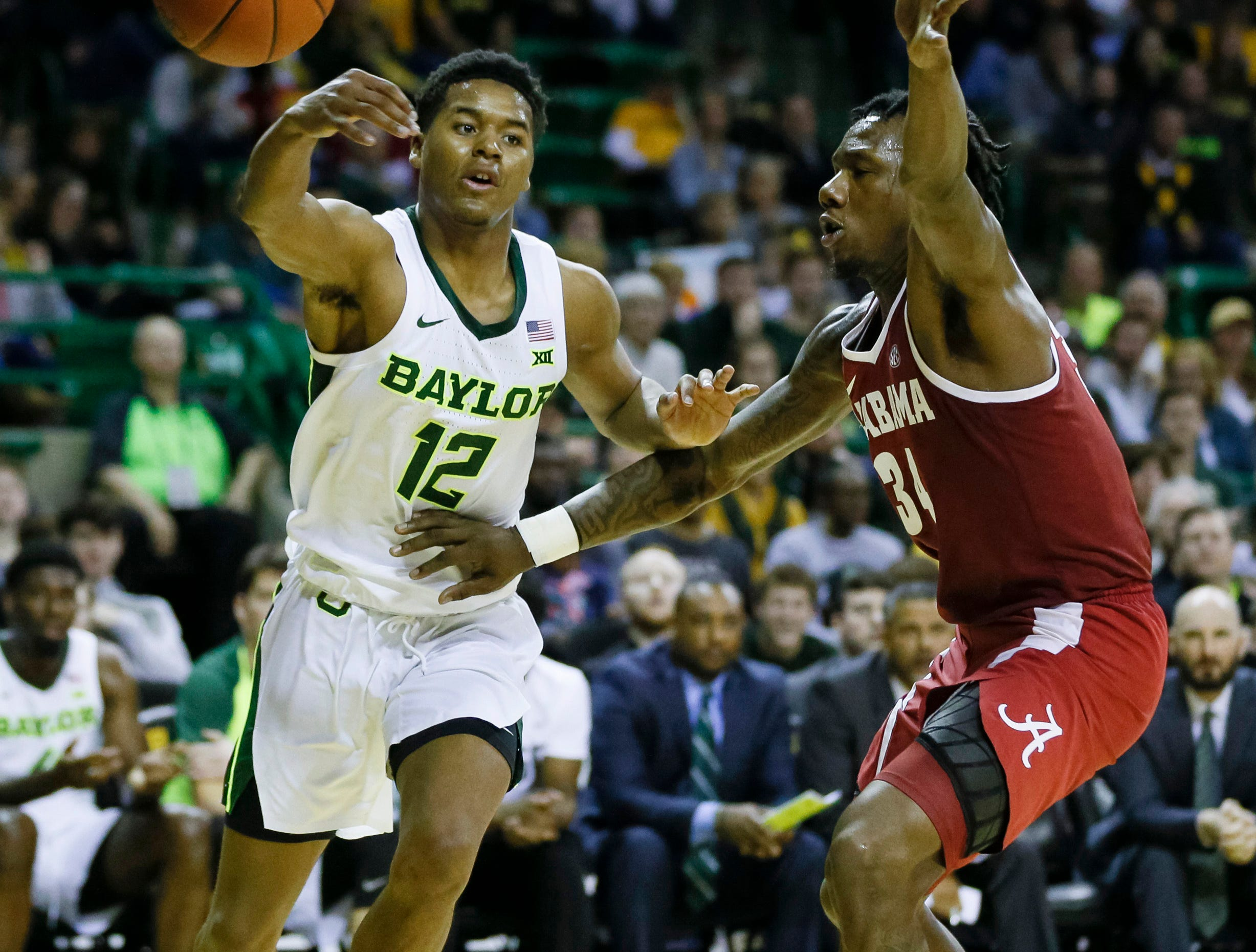 Jan 26, 2019; Waco, TX, USA; Baylor Bears guard Jared Butler (12) passes the ball around Alabama Crimson Tide guard Tevin Mack (34) during the second half at Ferrell Center. Mandatory Credit: Ray Carlin-USA TODAY Sports