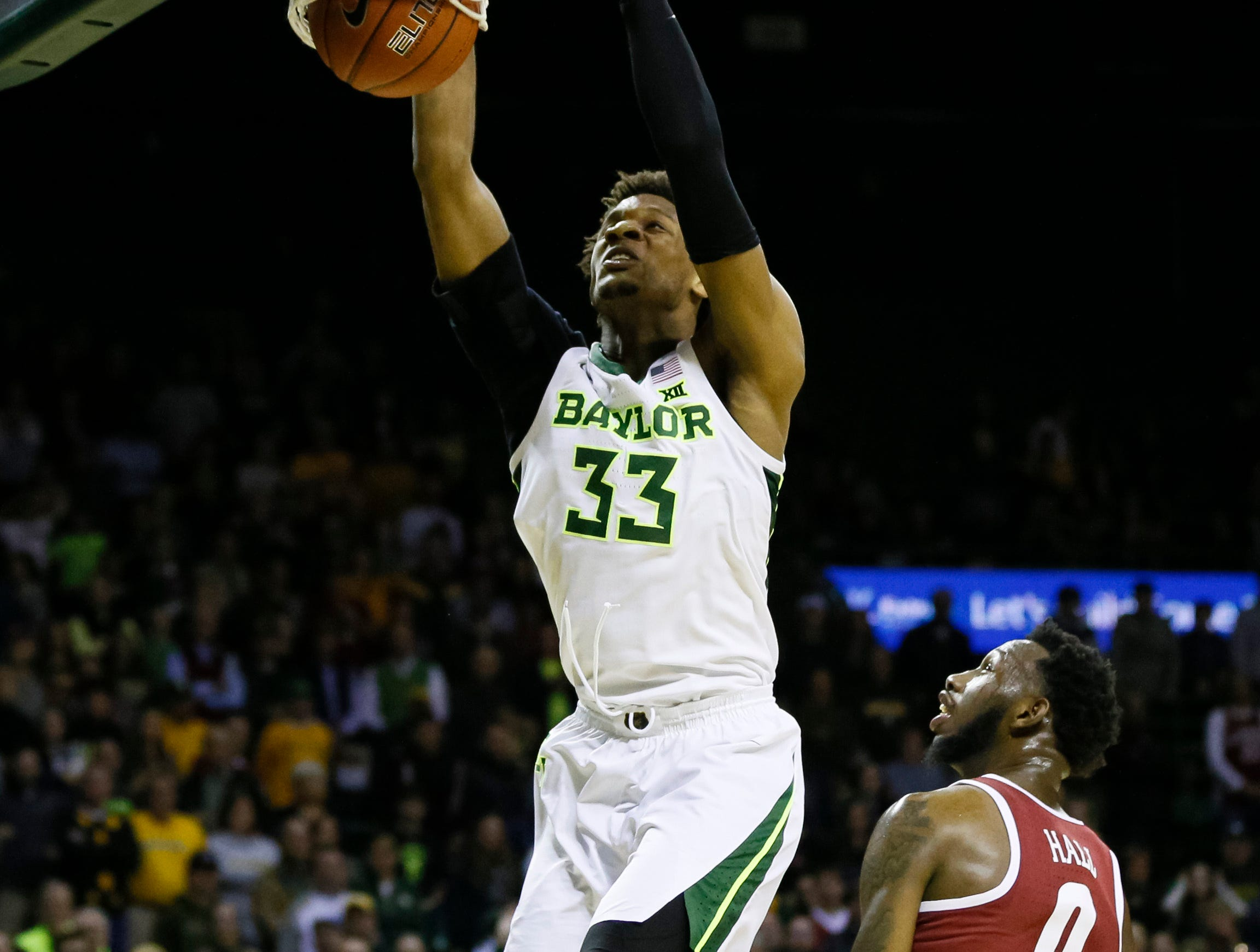 Jan 26, 2019; Waco, TX, USA; Baylor Bears forward Freddie Gillespie (33) follows thru on a dunk over Alabama Crimson Tide forward Donta Hall (0) during the second half at Ferrell Center. Mandatory Credit: Ray Carlin-USA TODAY Sports