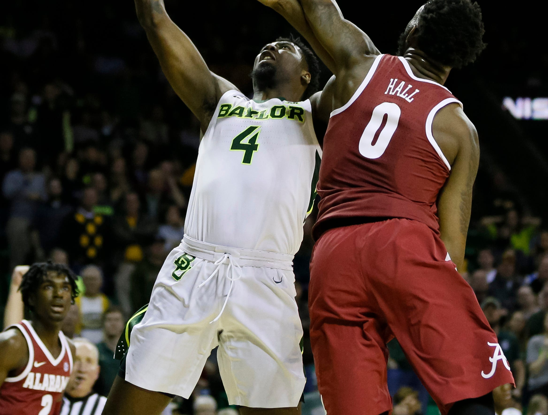 Jan 26, 2019; Waco, TX, USA; Baylor Bears guard Mario Kegler (4) takes the ball to the basket on Alabama Crimson Tide forward Donta Hall (0) during the second half at Ferrell Center. Mandatory Credit: Ray Carlin-USA TODAY Sports