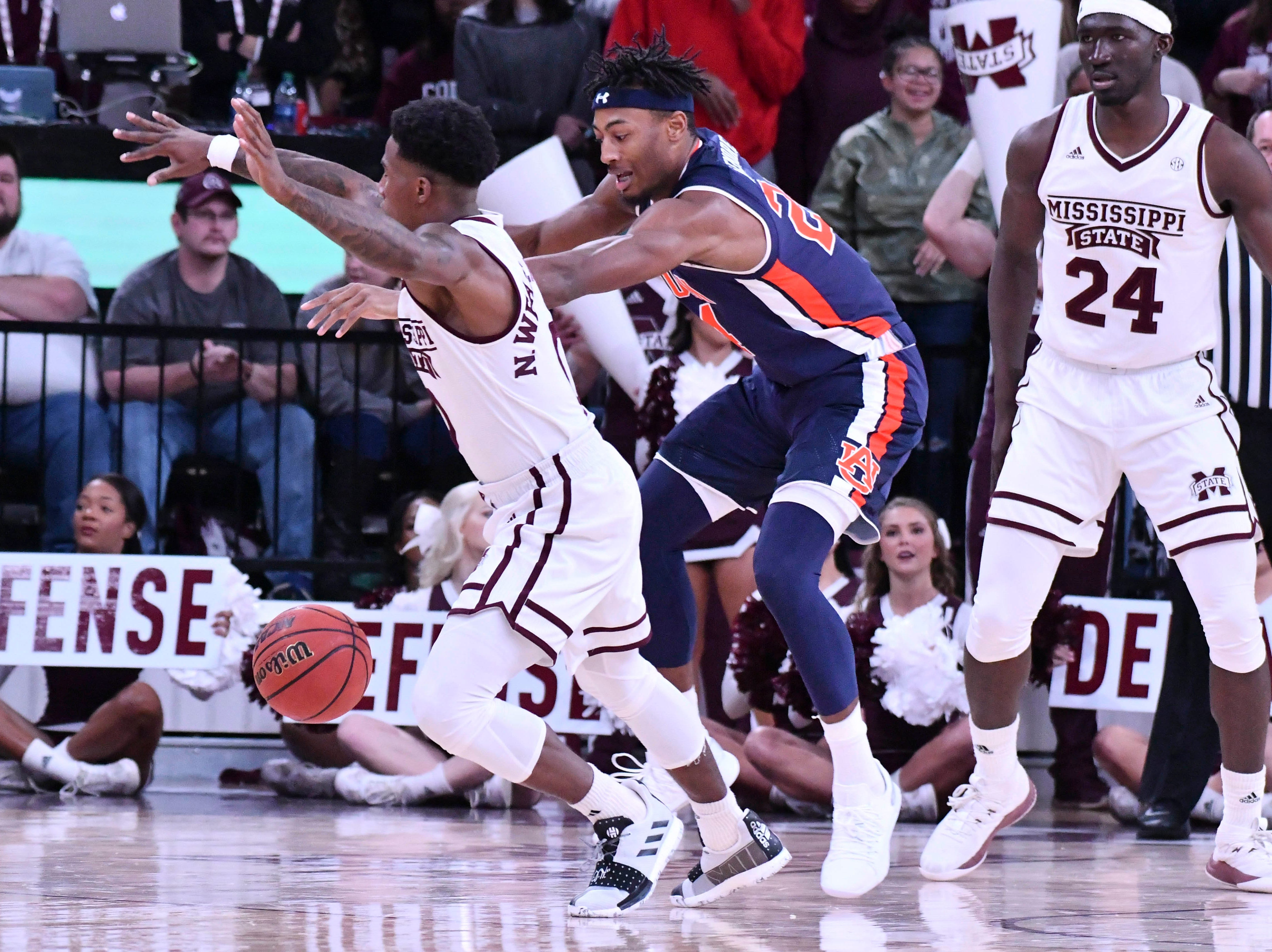 Jan 26, 2019; Starkville, MS, USA; Mississippi State Bulldogs guard Nick Weatherspoon (0) and Auburn Tigers forward Anfernee McLemore (24) battle for a loose ball during the first half at Humphrey Coliseum. Mandatory Credit: Matt Bush-USA TODAY Sports