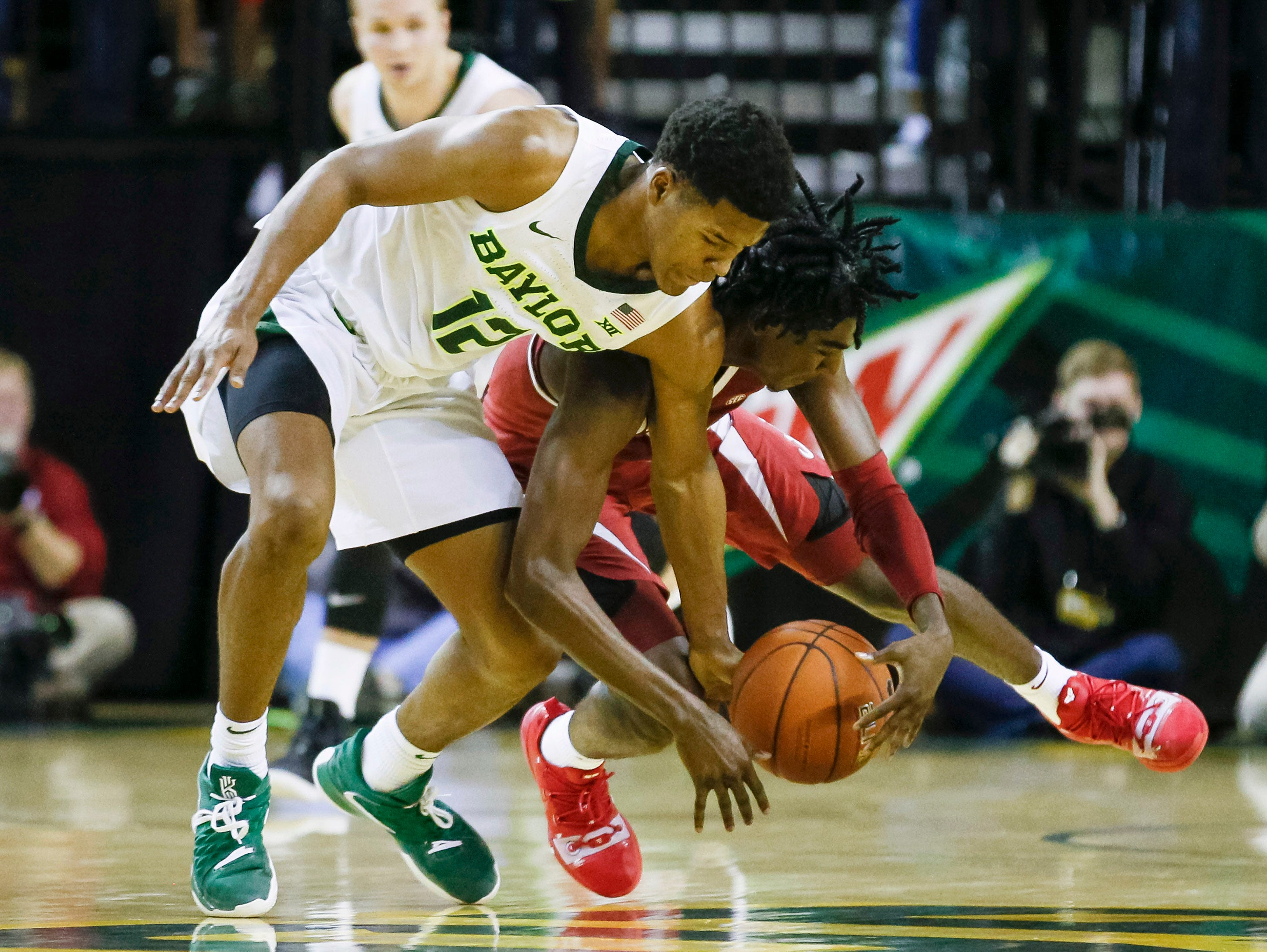 Jan 26, 2019; Waco, TX, USA; Baylor Bears guard Jared Butler (12) and Alabama Crimson Tide guard Kira Lewis Jr. (2) battle for the loose ball during the second half at Ferrell Center. Mandatory Credit: Ray Carlin-USA TODAY Sports