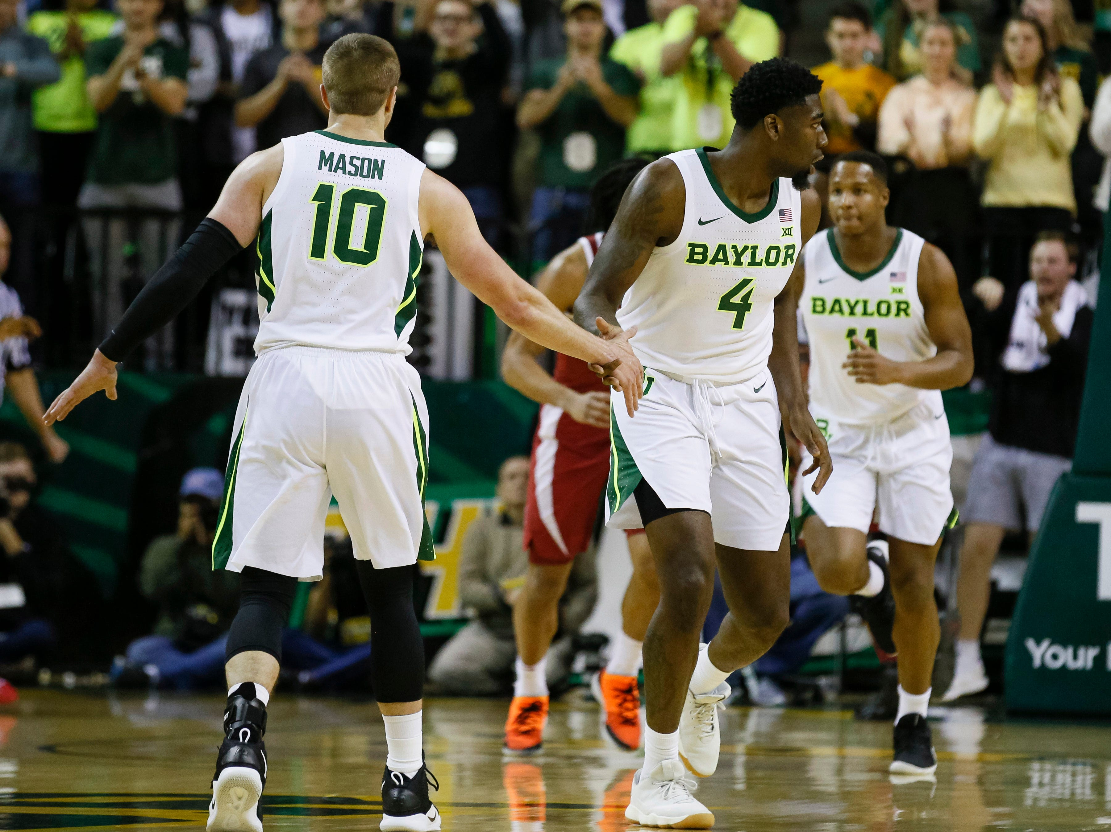 Jan 26, 2019; Waco, TX, USA; Baylor Bears guard Mario Kegler (4) celebrates with guard Makai Mason (10) after scoring against the Alabama Crimson Tide during the first half at Ferrell Center. Mandatory Credit: Ray Carlin-USA TODAY Sports
