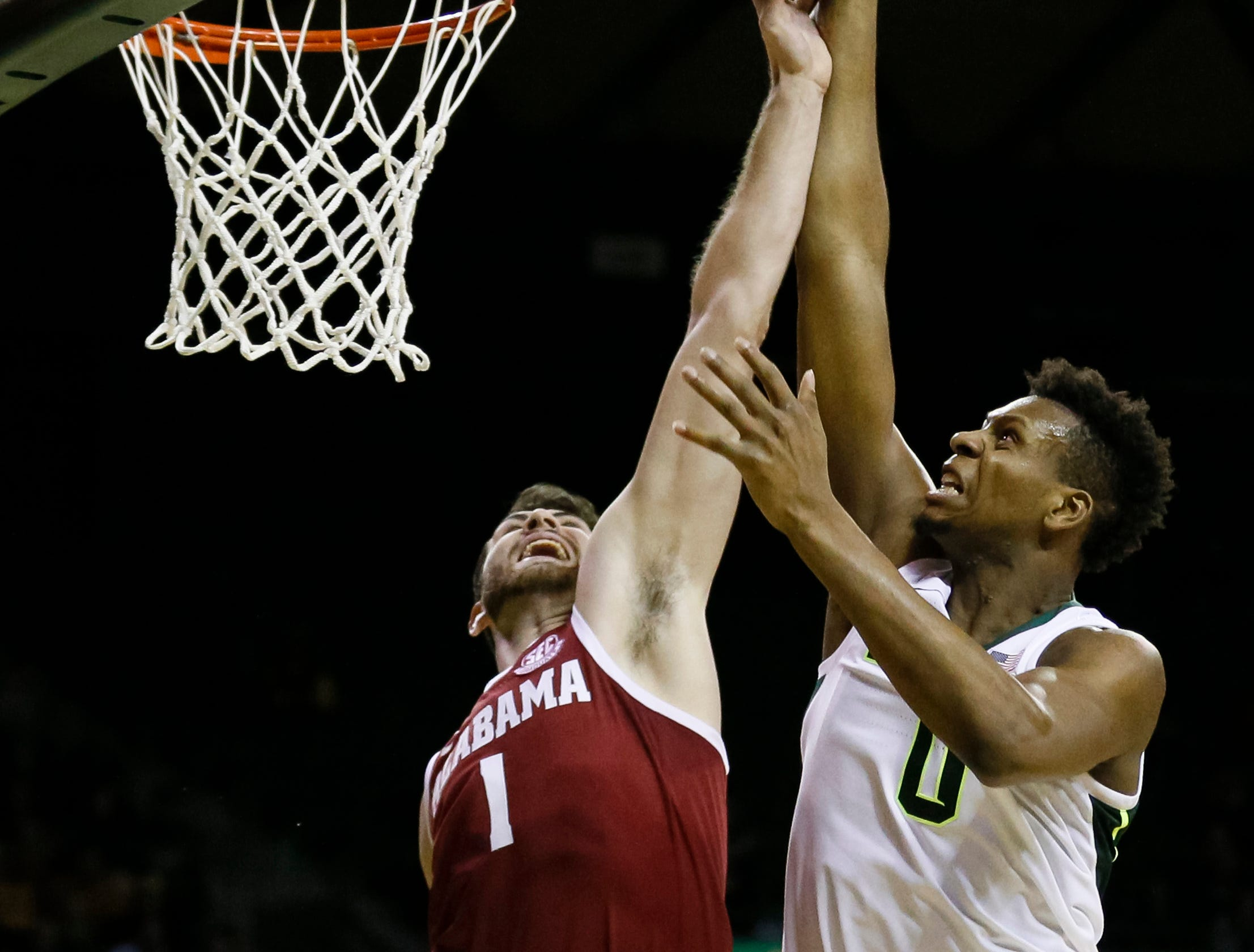 Jan 26, 2019; Waco, TX, USA; Alabama Crimson Tide guard Riley Norris (1) makes the block on Baylor Bears forward Flo Thamba (0) during the second half at Ferrell Center. Mandatory Credit: Ray Carlin-USA TODAY Sports
