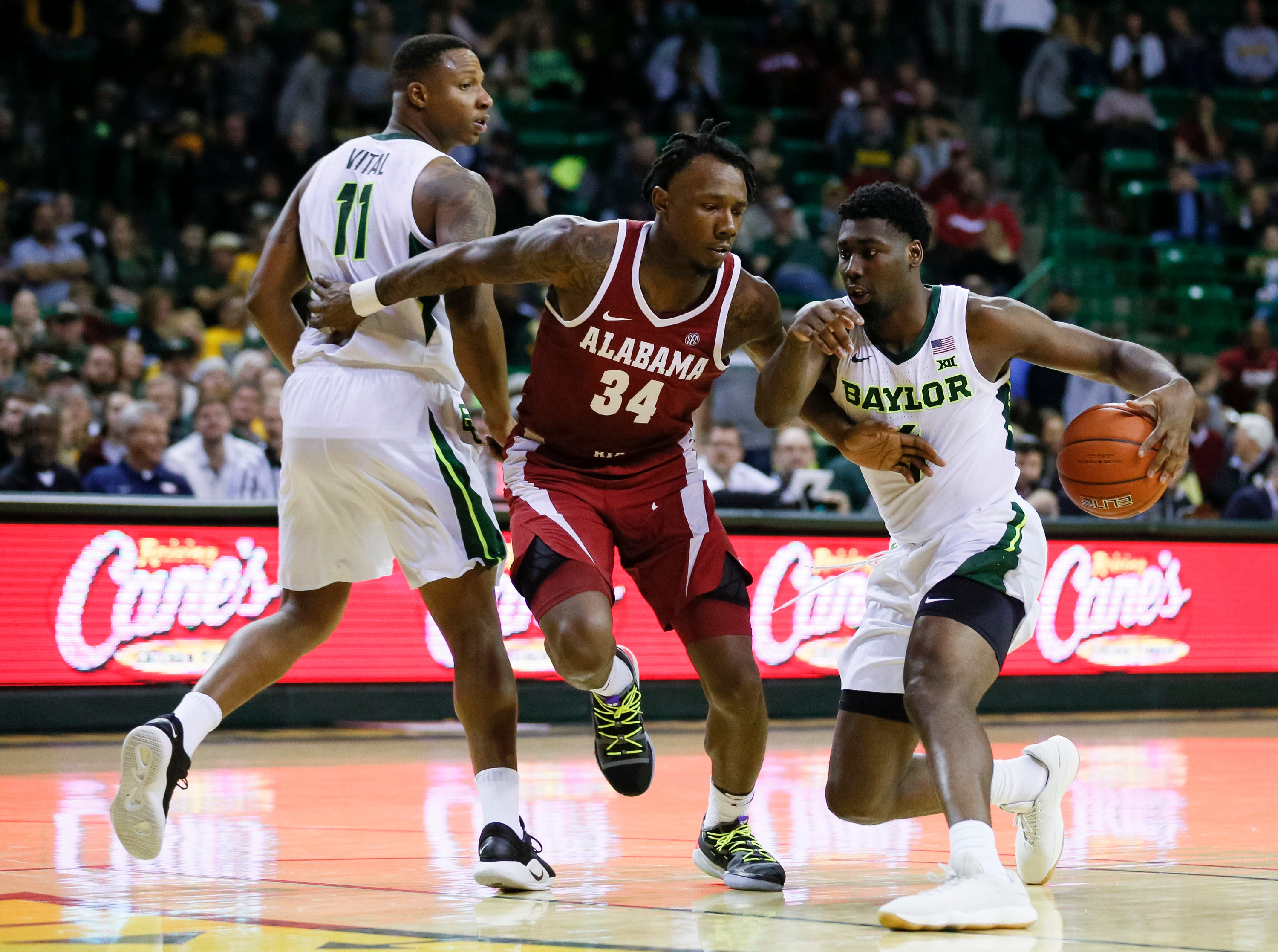 Jan 26, 2019; Waco, TX, USA; Baylor Bears guard Mario Kegler (4) dribbles the all around Bears guard Mark Vital (11) and Alabama Crimson Tide guard Tevin Mack (34) during the second half at Ferrell Center. Mandatory Credit: Ray Carlin-USA TODAY Sports