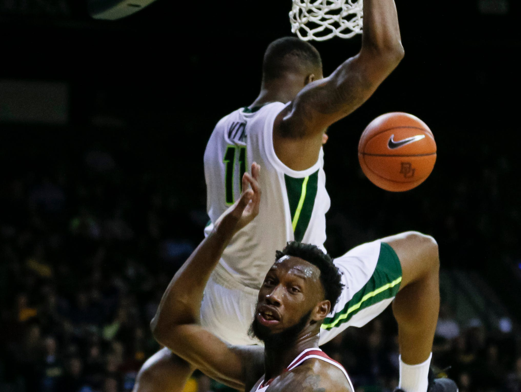 Jan 26, 2019; Waco, TX, USA; Baylor Bears guard Mark Vital (11) dunks over Alabama Crimson Tide forward Donta Hall (0) during the second half at Ferrell Center. Mandatory Credit: Ray Carlin-USA TODAY Sports