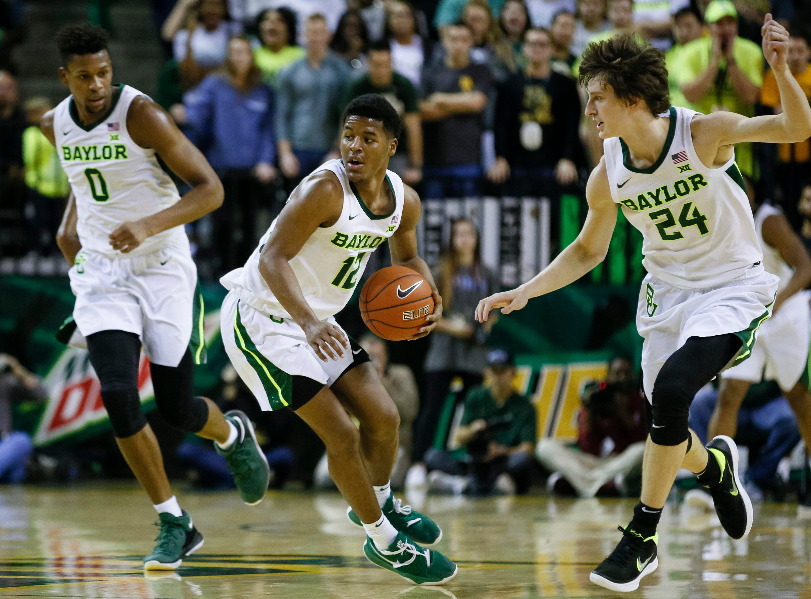 Jan 26, 2019; Waco, TX, USA; Baylor Bears guard Jared Butler (12) picks up the loose ball during the second half against the Alabama Crimson Tide at Ferrell Center. Mandatory Credit: Ray Carlin-USA TODAY Sports