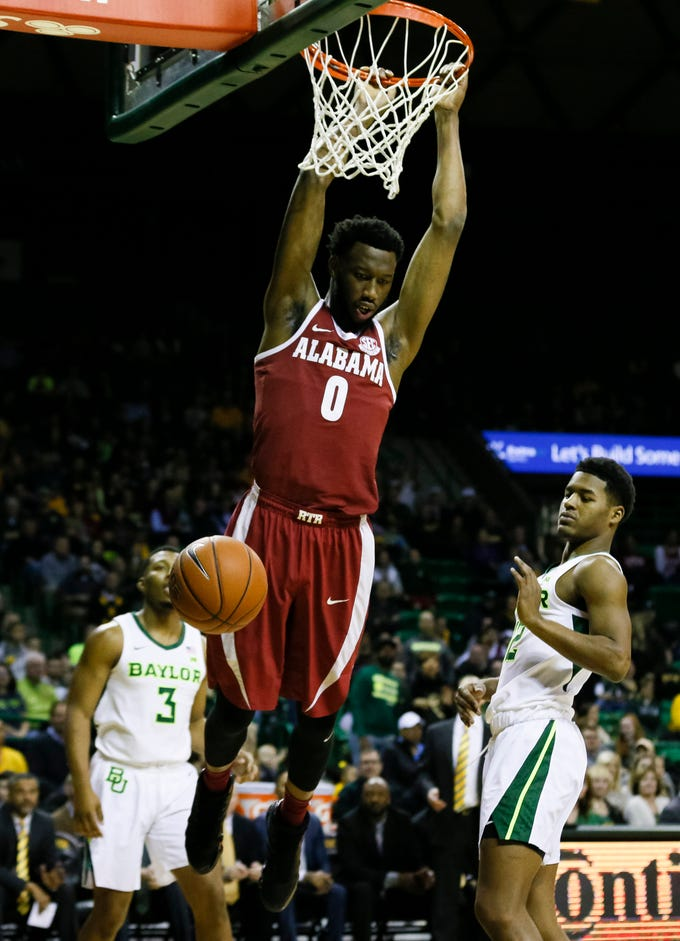 Jan 26, 2019; Waco, TX, USA; Alabama Crimson Tide forward Donta Hall (0) follows thru on the dunk as Baylor Bears guard Jared Butler (12) and guard King McClure (3) look on during the first half at Ferrell Center. Mandatory Credit: Ray Carlin-USA TODAY Sports