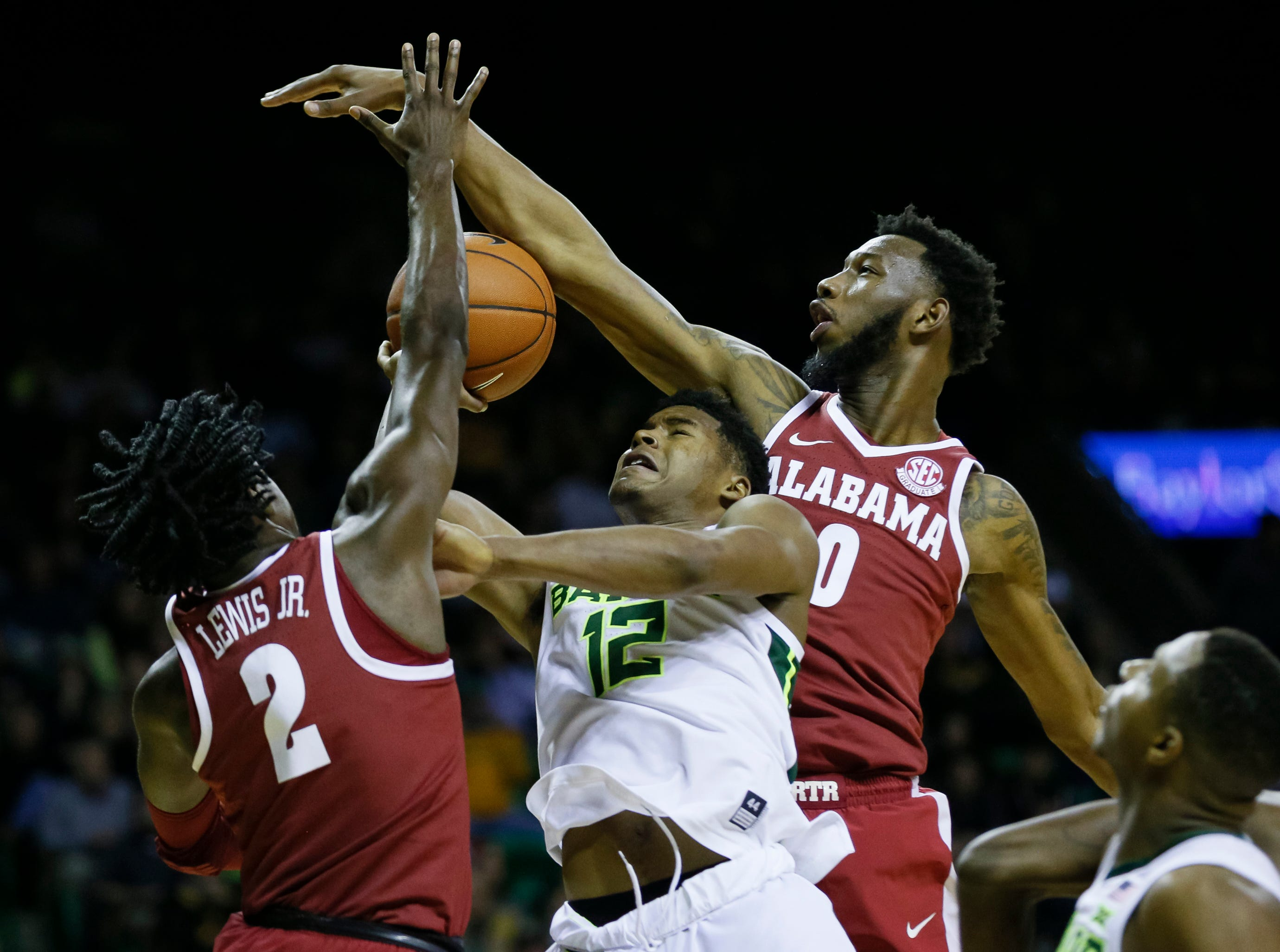 Jan 26, 2019; Waco, TX, USA; Alabama Crimson Tide guard Kira Lewis Jr. (2) and forward Donta Hall (0) defend Baylor Bears guard Jared Butler (12) under the basket during the second half at Ferrell Center. Mandatory Credit: Ray Carlin-USA TODAY Sports