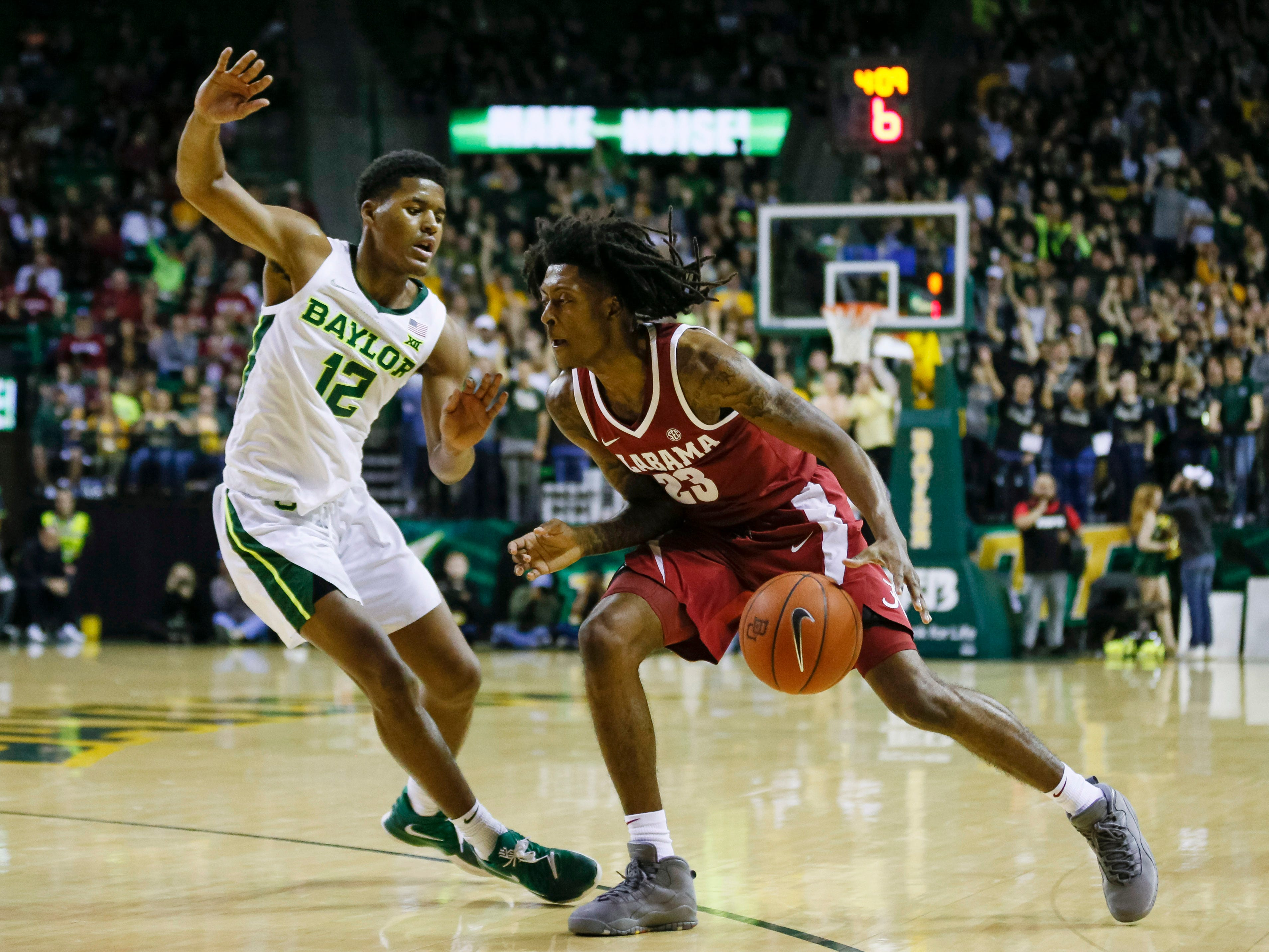 Jan 26, 2019; Waco, TX, USA; Alabama Crimson Tide guard John Petty (23) dribbles the ball as Baylor Bears guard Jared Butler (12) defends during the first half at Ferrell Center. Mandatory Credit: Ray Carlin-USA TODAY Sports
