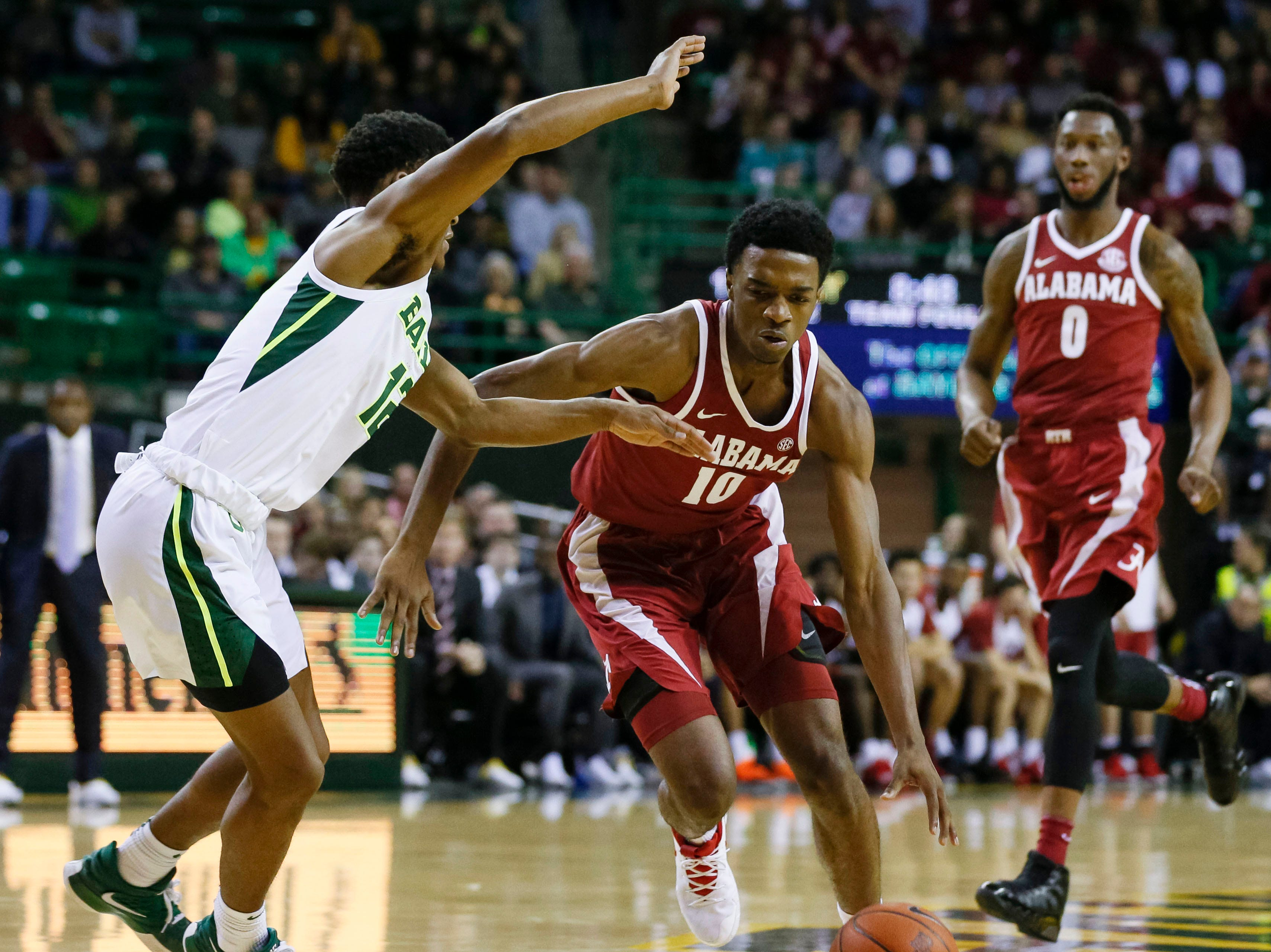 Jan 26, 2019; Waco, TX, USA; Alabama Crimson Tide guard Herbert Jones (10) dribbles the ball past Baylor Bears guard Jared Butler (12) during the first half at Ferrell Center. Mandatory Credit: Ray Carlin-USA TODAY Sports