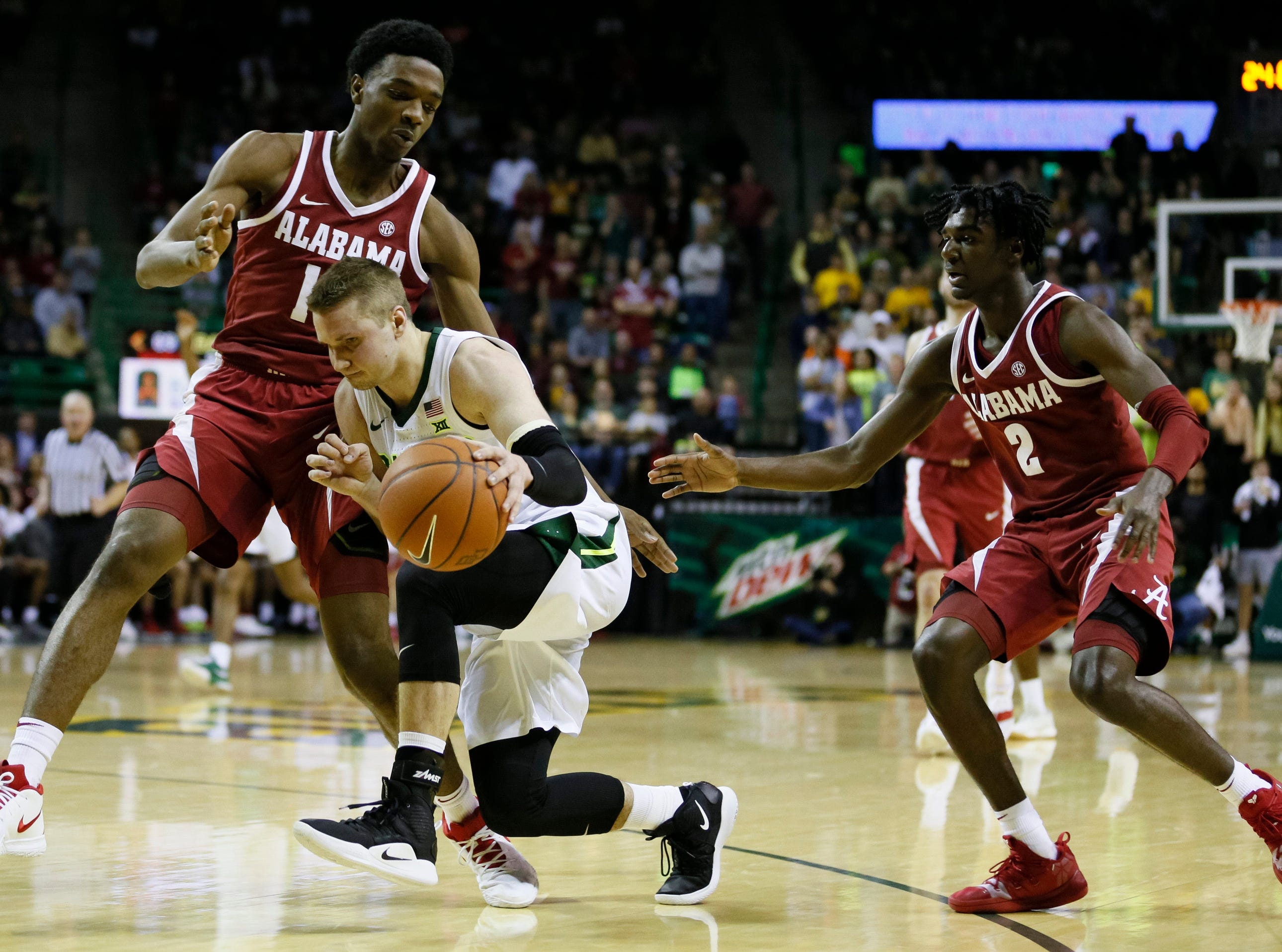 Jan 26, 2019; Waco, TX, USA; Baylor Bears guard Makai Mason (10) is fouled by Alabama Crimson Tide guard Herbert Jones (10) during the second half at Ferrell Center. Mandatory Credit: Ray Carlin-USA TODAY Sports