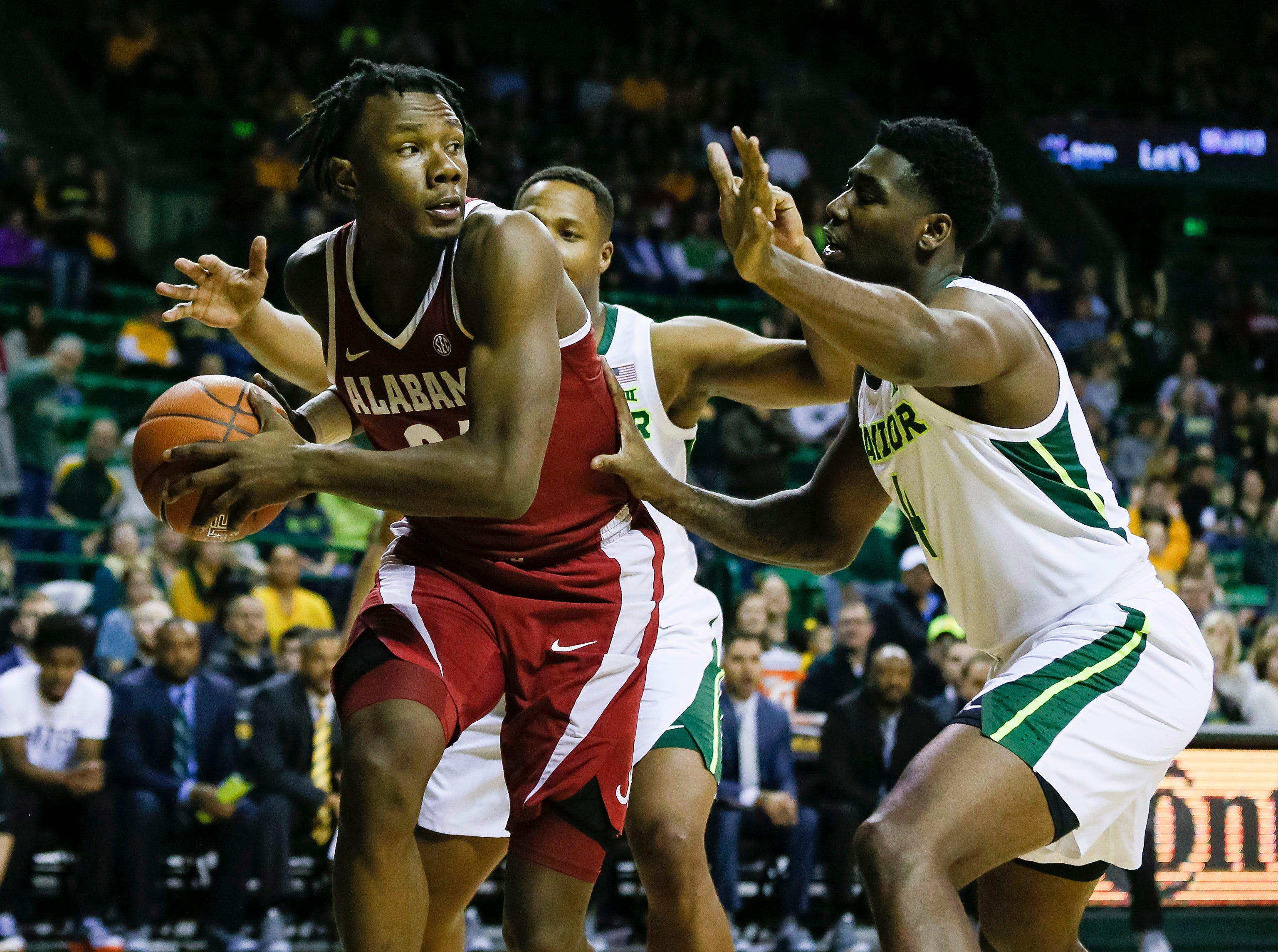 Jan 26, 2019; Waco, TX, USA; Alabama Crimson Tide guard Tevin Mack (34) controls the ball in front of Baylor Bears guard Mark Vital (11) and guard Mario Kegler (4) during the first half at Ferrell Center. Mandatory Credit: Ray Carlin-USA TODAY Sports