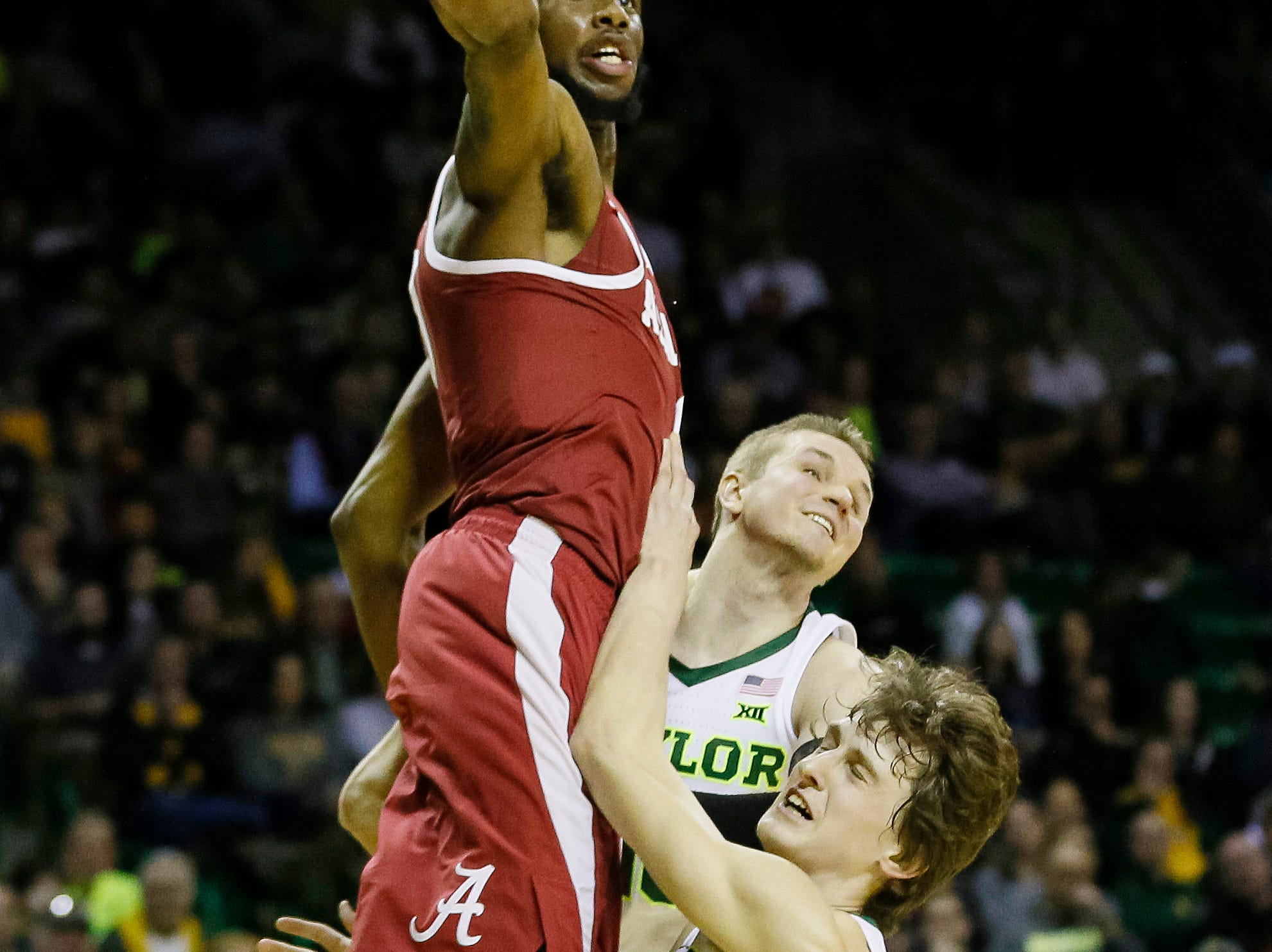 Jan 26, 2019; Waco, TX, USA; Alabama Crimson Tide forward Donta Hall (0) reaches for a rebound as Baylor Bears guard Makai Mason (10) and guard Matthew Mayer (24) defend during the first half at Ferrell Center. Mandatory Credit: Ray Carlin-USA TODAY Sports