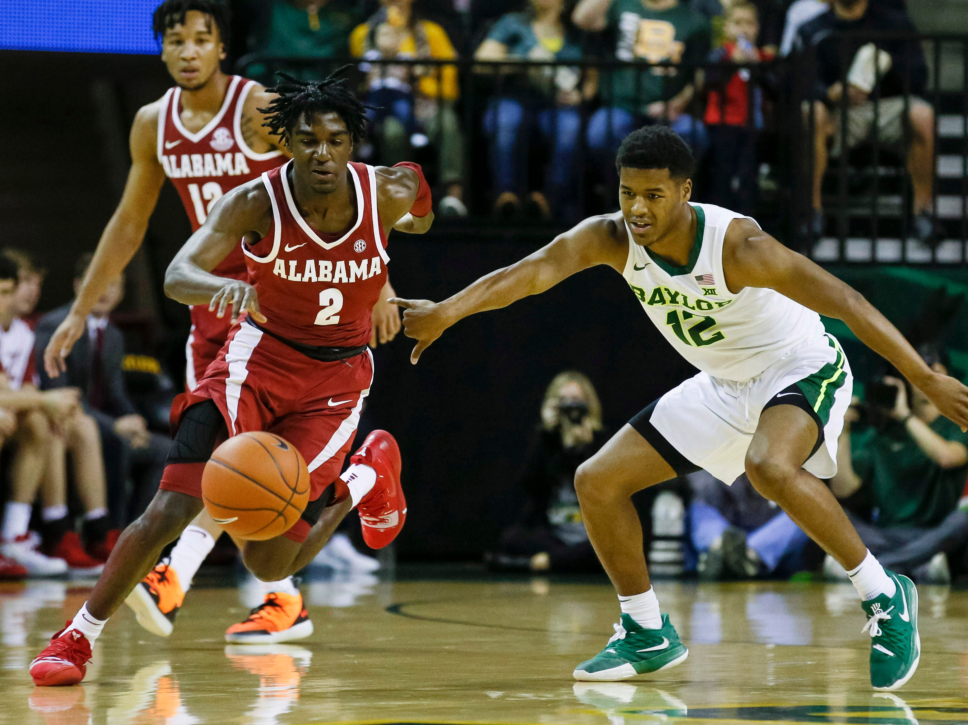 Jan 26, 2019; Waco, TX, USA; Alabama Crimson Tide guard Kira Lewis Jr. (2) battles for the ball with Baylor Bears guard Jared Butler (12) during the first half at Ferrell Center. Mandatory Credit: Ray Carlin-USA TODAY Sports