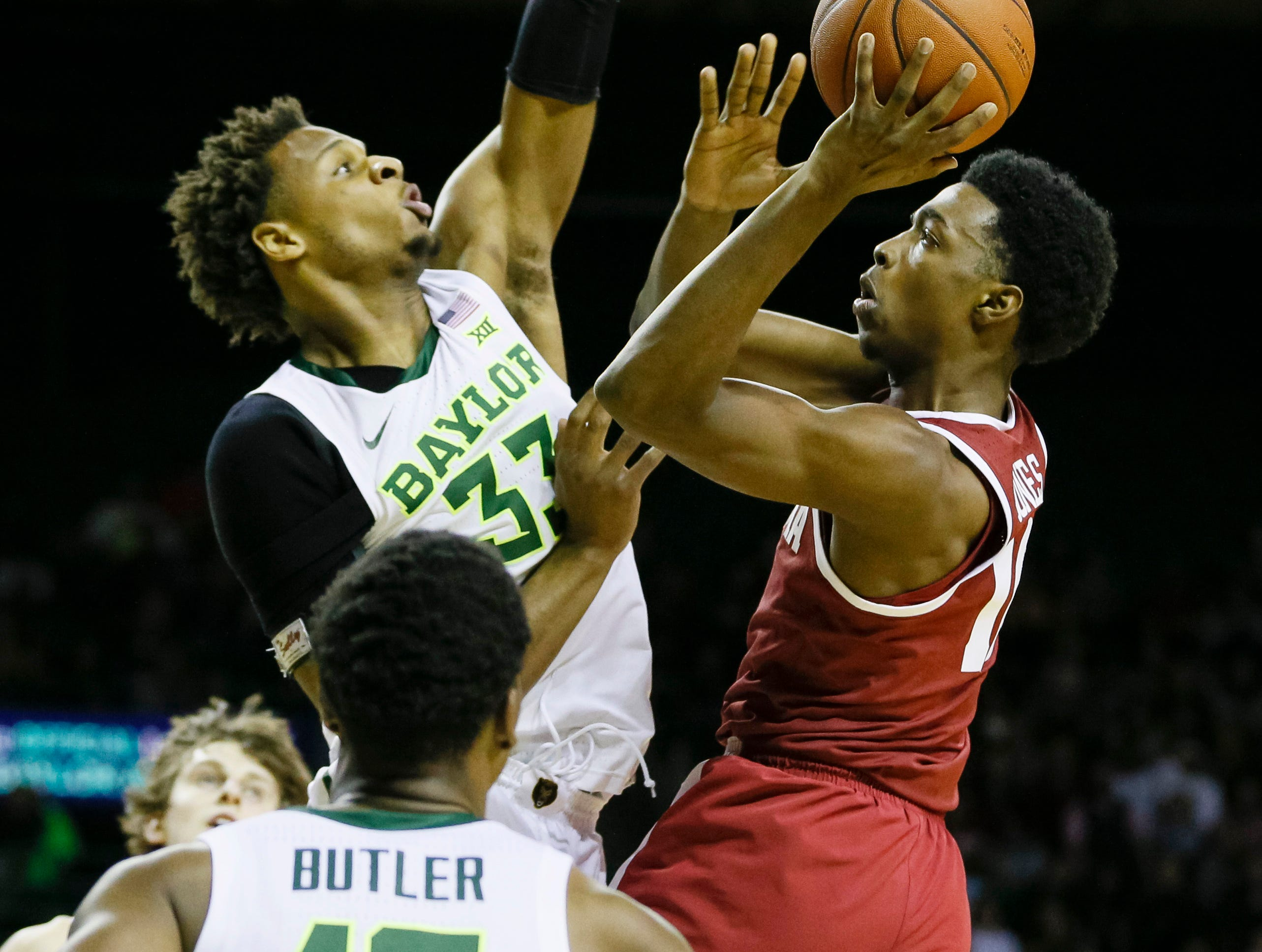 Jan 26, 2019; Waco, TX, USA; Alabama Crimson Tide guard Herbert Jones (10) shoot the ball as Baylor Bears forward Freddie Gillespie (33) defends during the first half at Ferrell Center. Mandatory Credit: Ray Carlin-USA TODAY Sports