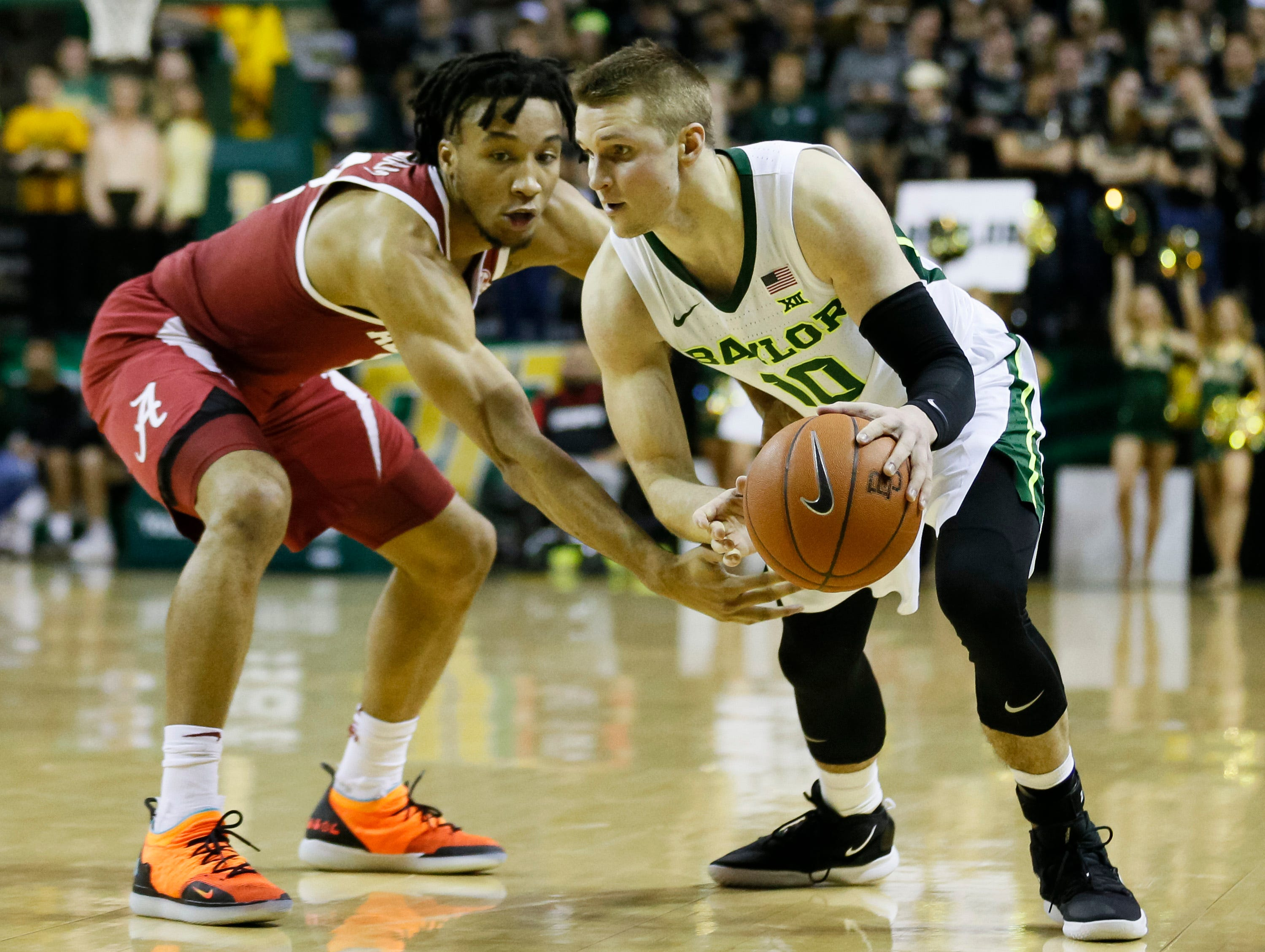 Jan 26, 2019; Waco, TX, USA; Baylor Bears guard Makai Mason (10) works around Alabama Crimson Tide guard Dazon Ingram (12) during the second half at Ferrell Center. Mandatory Credit: Ray Carlin-USA TODAY Sports