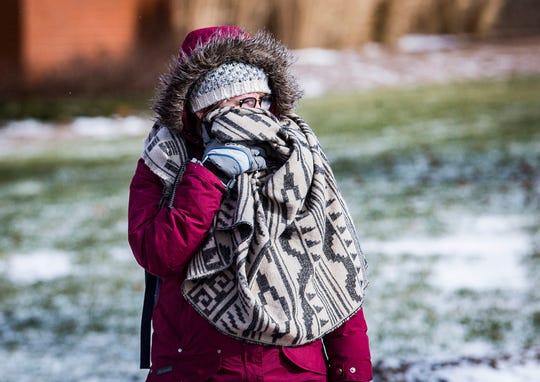 Ball State students battle frigid wind ahead of Wednesday's predicted sub zero temperatures Tuesday afternoon.