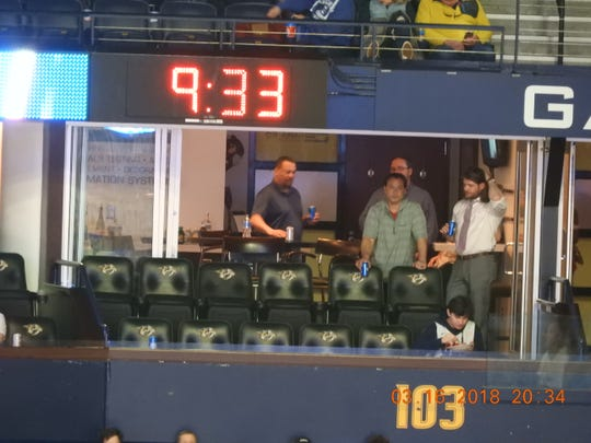 Collier Engineering officials in a Bridgestone Arena suite in March.